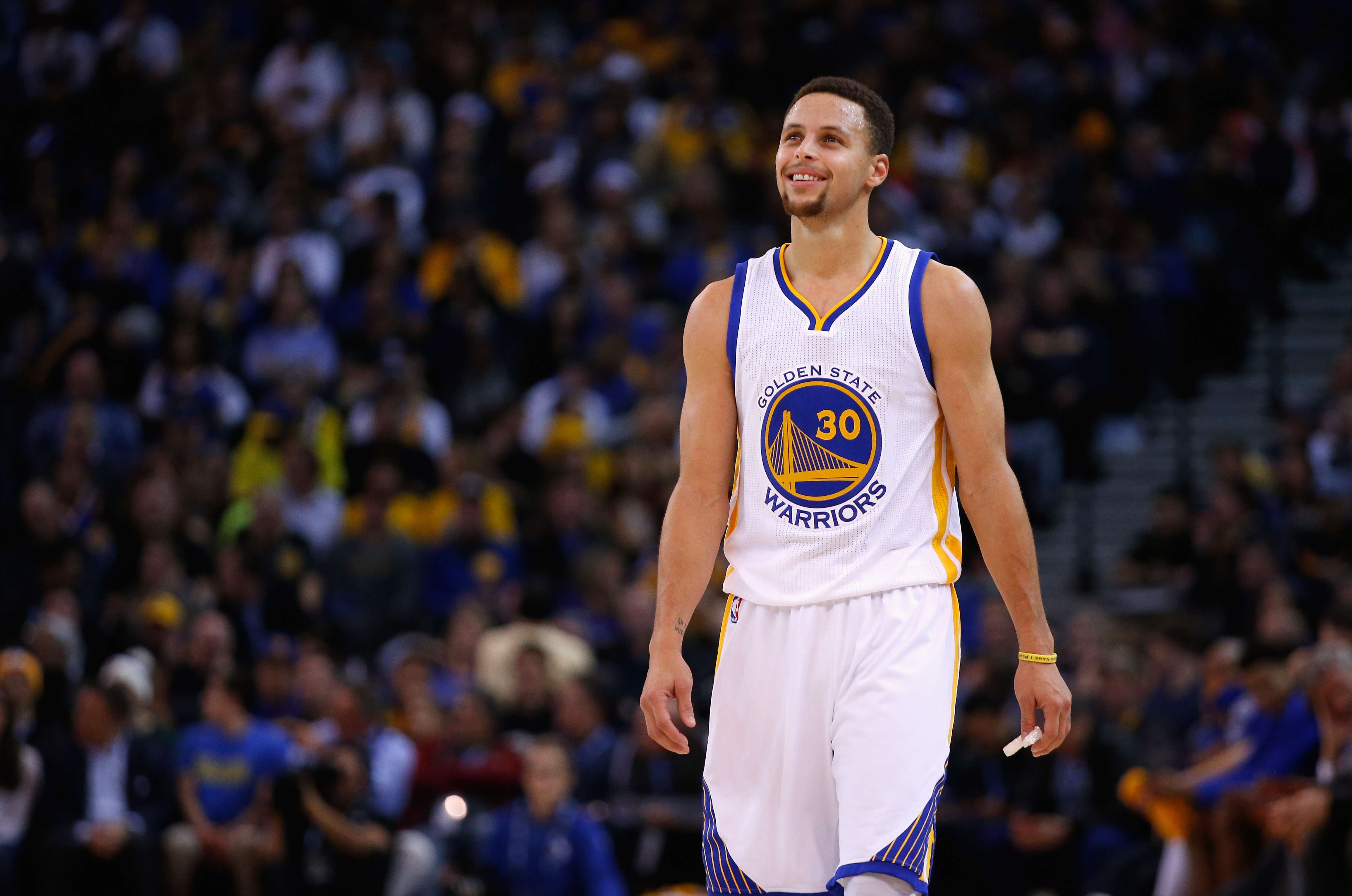 Stephen Curry of the Golden State Warriors plays against the Suns at ORACLE Arena on December 16, 2015 in Oakland, California.
