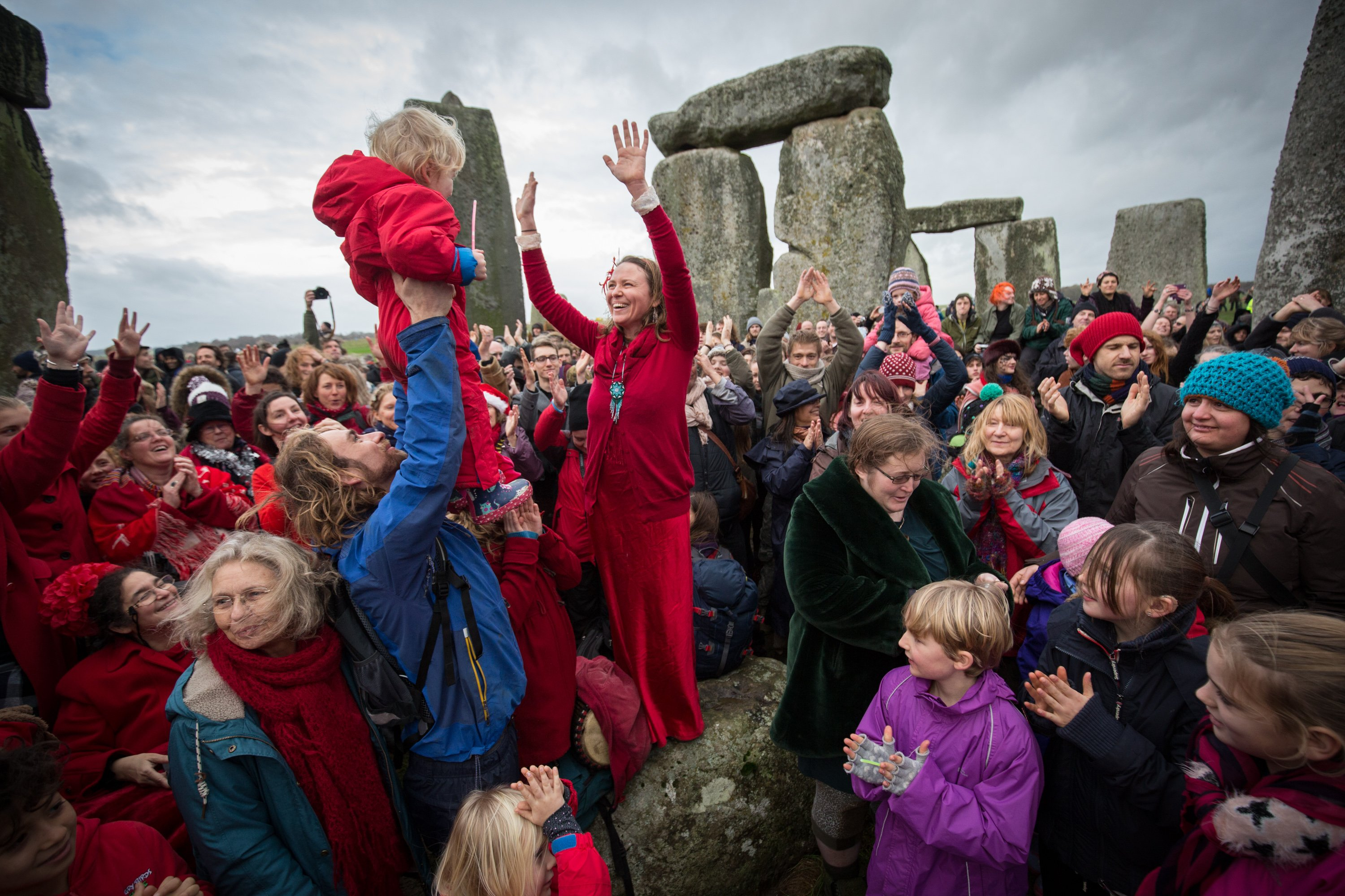 Susie Ro Prater leads the Shakti Sings choir as druids, pagans and revelers gather in the centre of Stonehenge on Dec. 22, 2015 in Wiltshire, England.