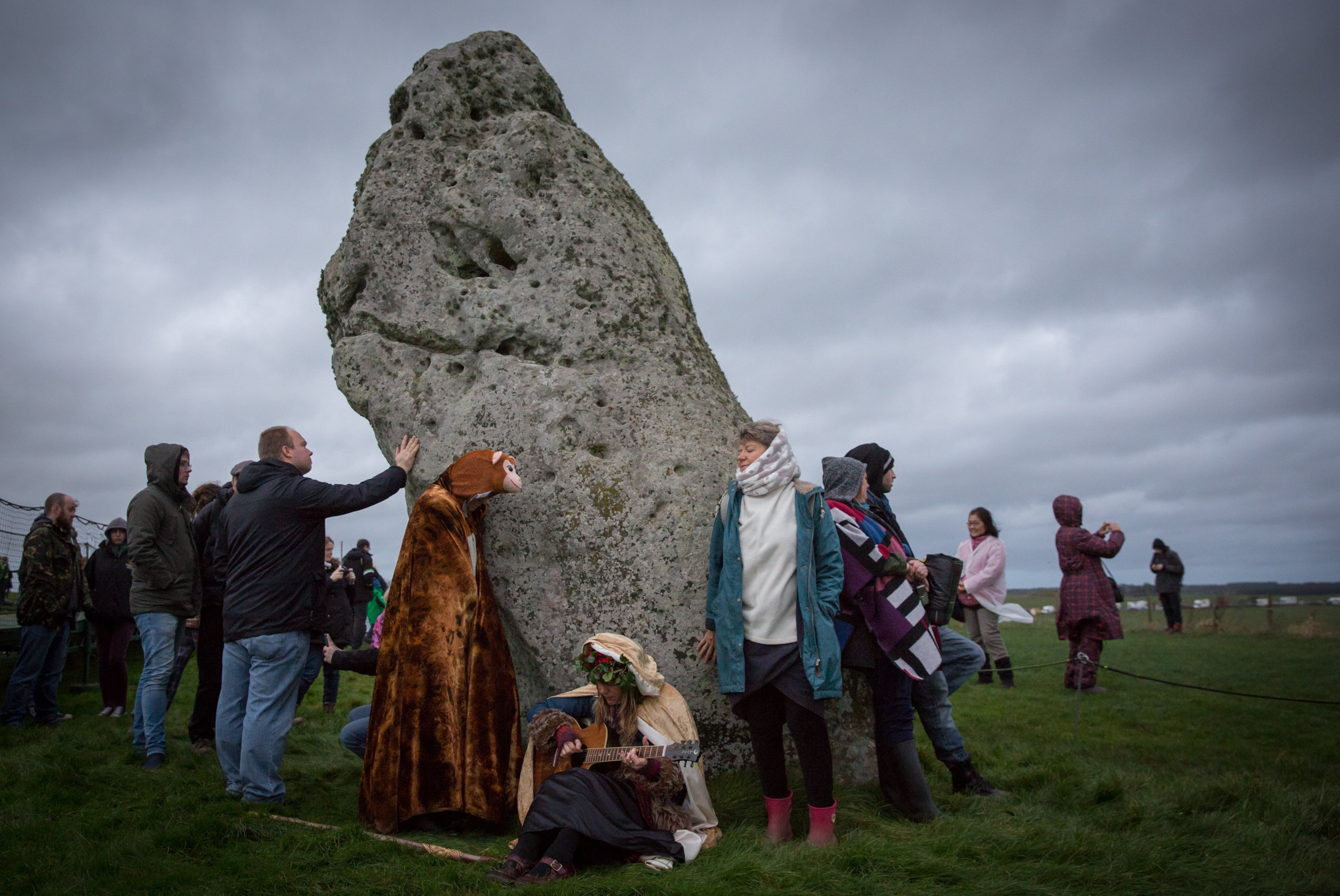 People gather at Stonehenge as they take part in a winter solstice ceremony on Dec. 22, 2015 in Wiltshire, England.