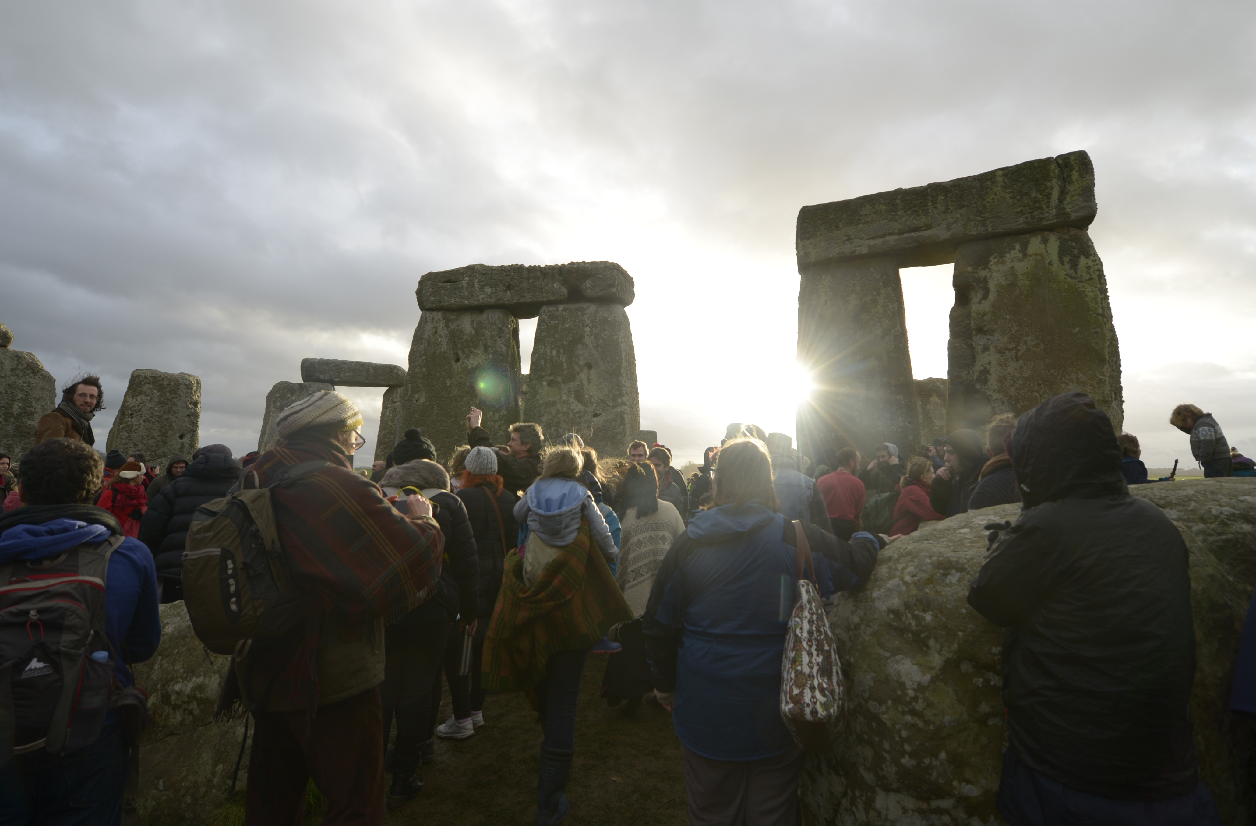 People gather at Stonehenge in Wiltshire on the Winter Solstice to witness the sunrise on the shortest day of the year, on Dec. 22, 2015.