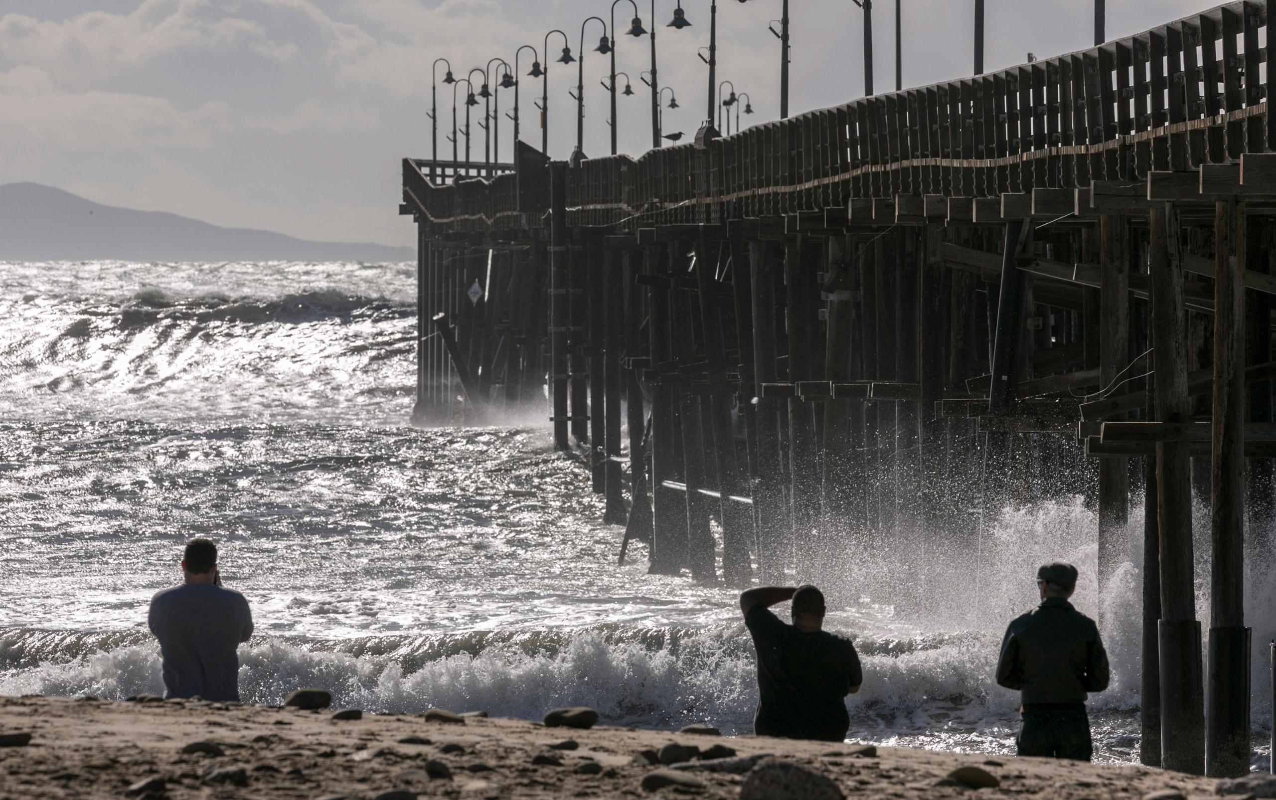 Rough seas surge over the Ventura Pier in Ventura, Calif., on Dec. 11, 2015.