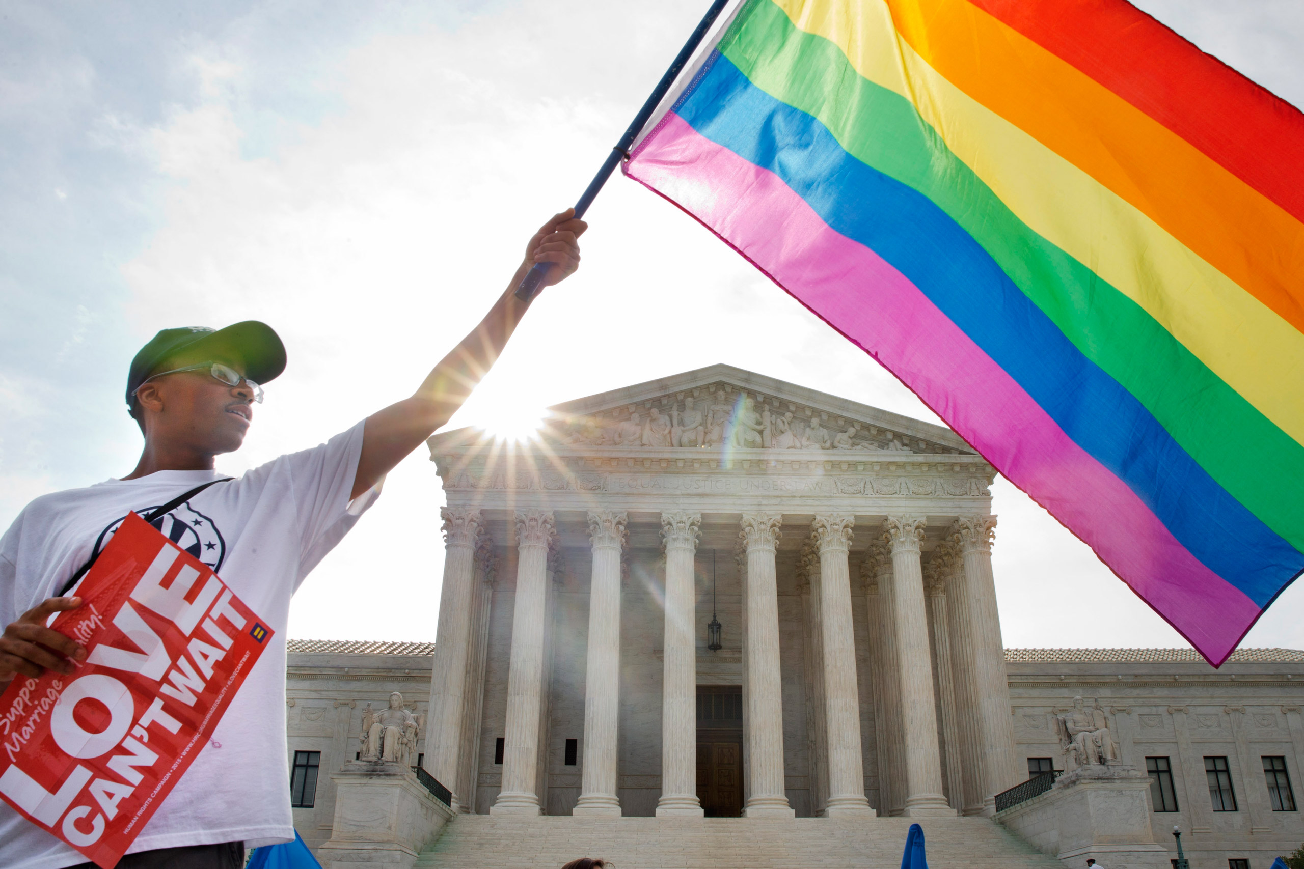 Carlos McKnight waves a flag in support of gay marriage outside of the Supreme Court in Washington on June 26, 2015.