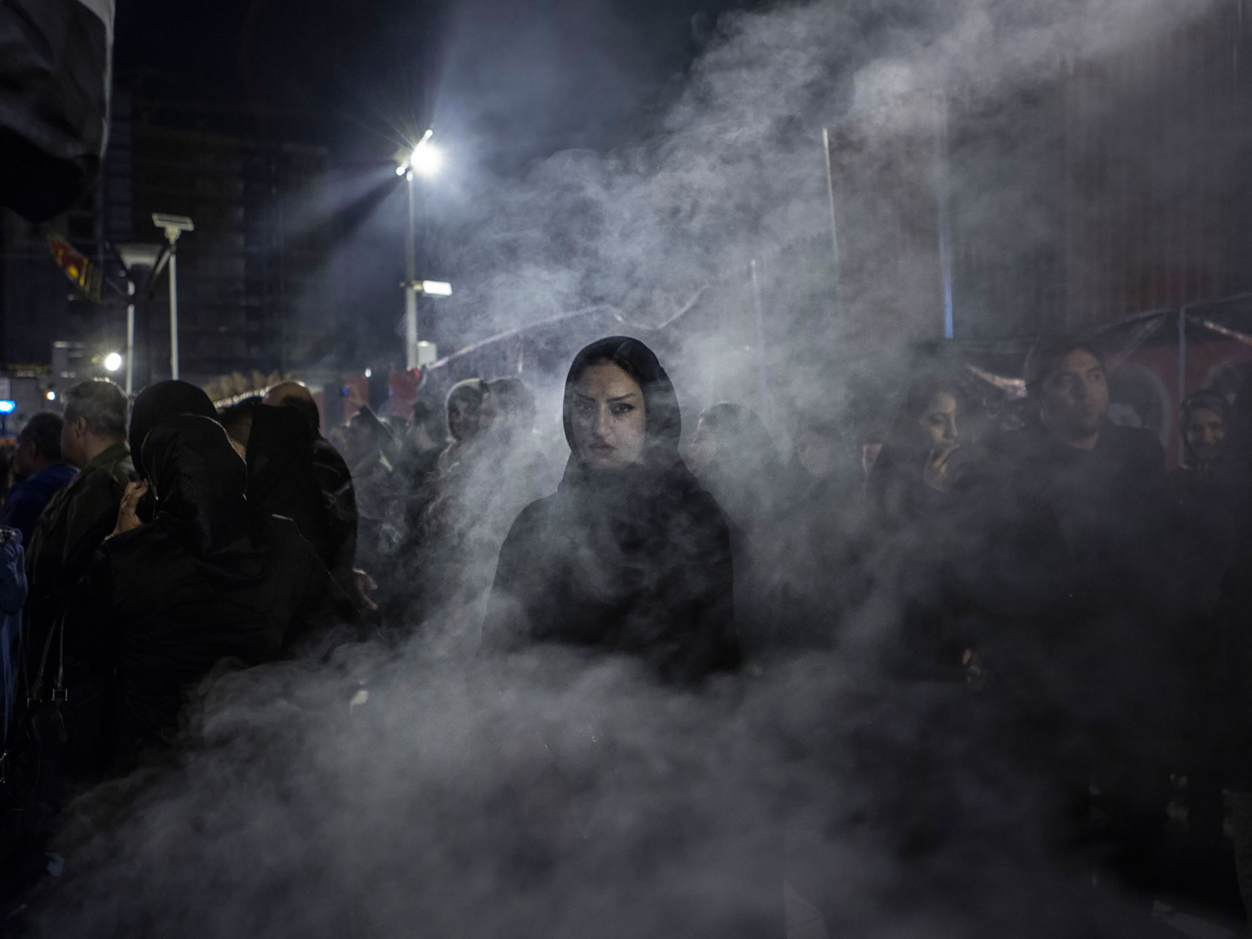 An Iranian woman walks through a haze of smoke caused by the burning of the herb esfand. According to popular belief, this ritual drives away the evil eye.From  See Iran Coming Out of the Shadows