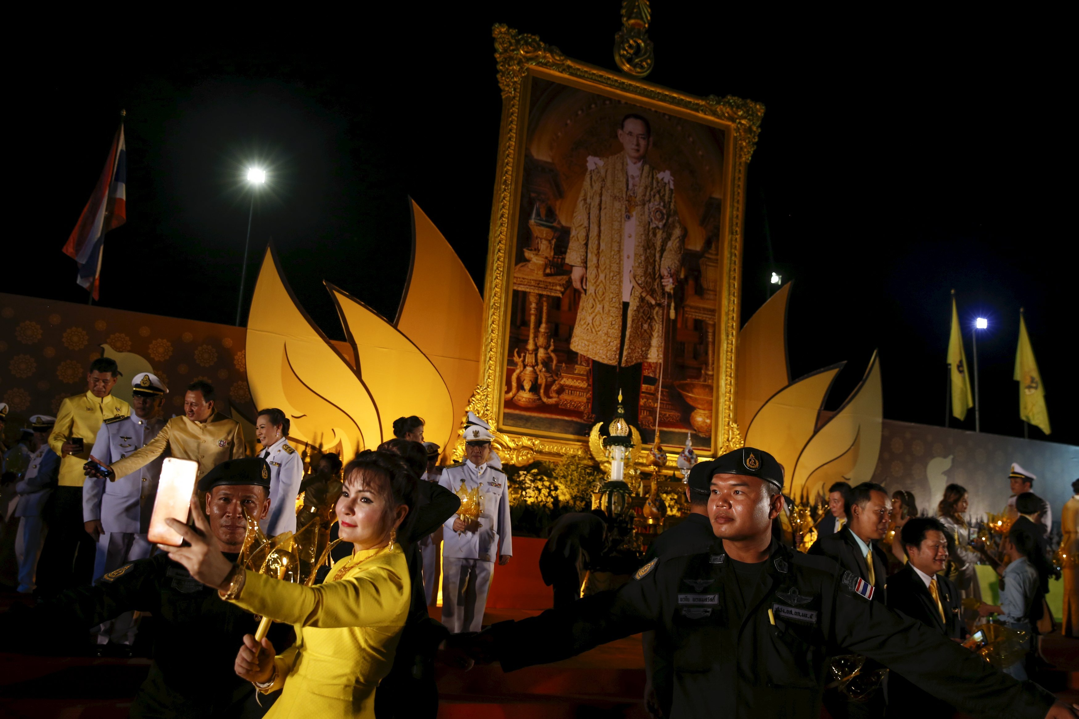 Army officials and guests pose after attending the official ceremony to celebrate Thailand's King Bhumibol Adulyadej 88th birthday in Bangkok, on Dec. 5, 2015.