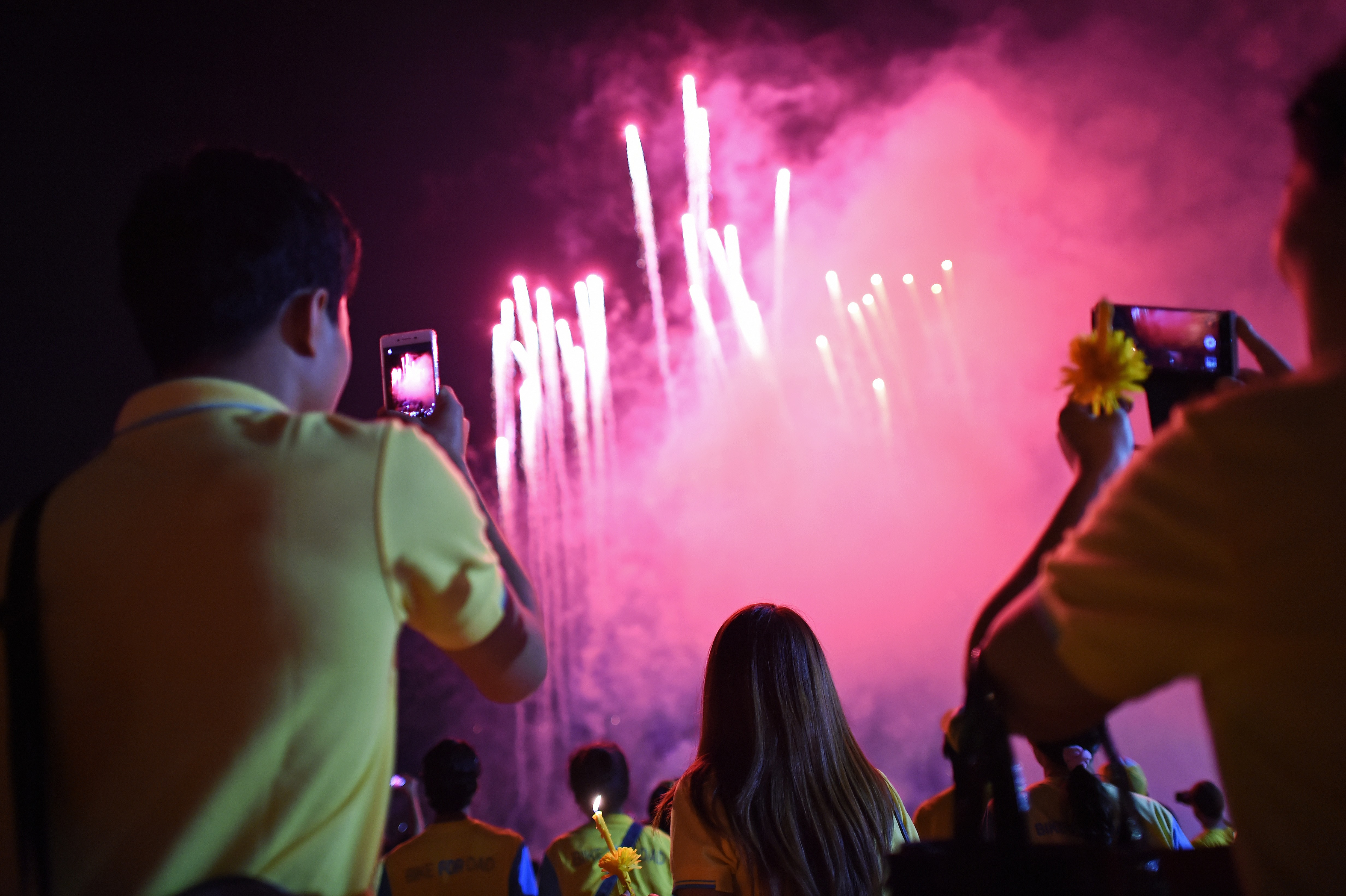 Thai well-wishers take pictures during celebrations of King Bhumibol Adulyadej's 88th birthday in Bangkok, on Dec. 5, 2015.