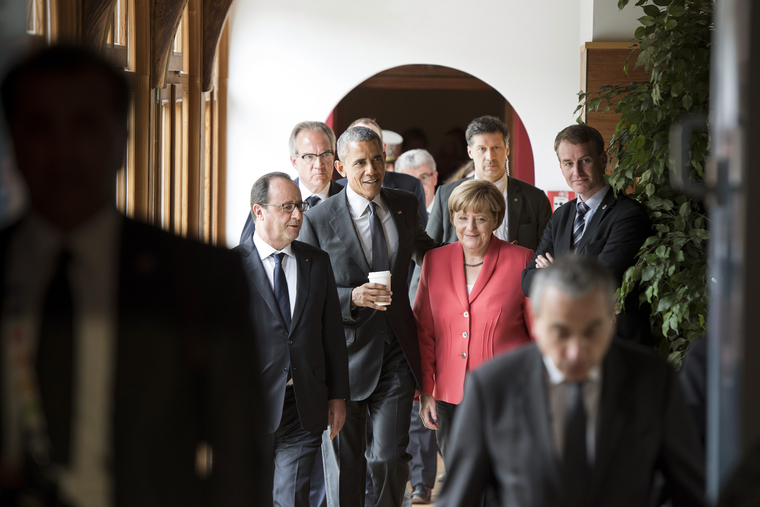 Federal Chancellor Angela Merkel, French President Francois Hollande and US President Barack Obama arrive to the G7/Outreach meeting during the G7 summit in Elmau. June 8, 2015.