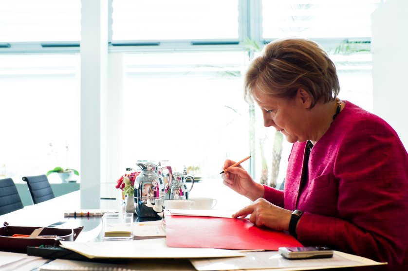 Chancellor Angela Merkel with paperwork at her desk in her office in the Federal Chancellery in Berlin. July 8, 2011.
