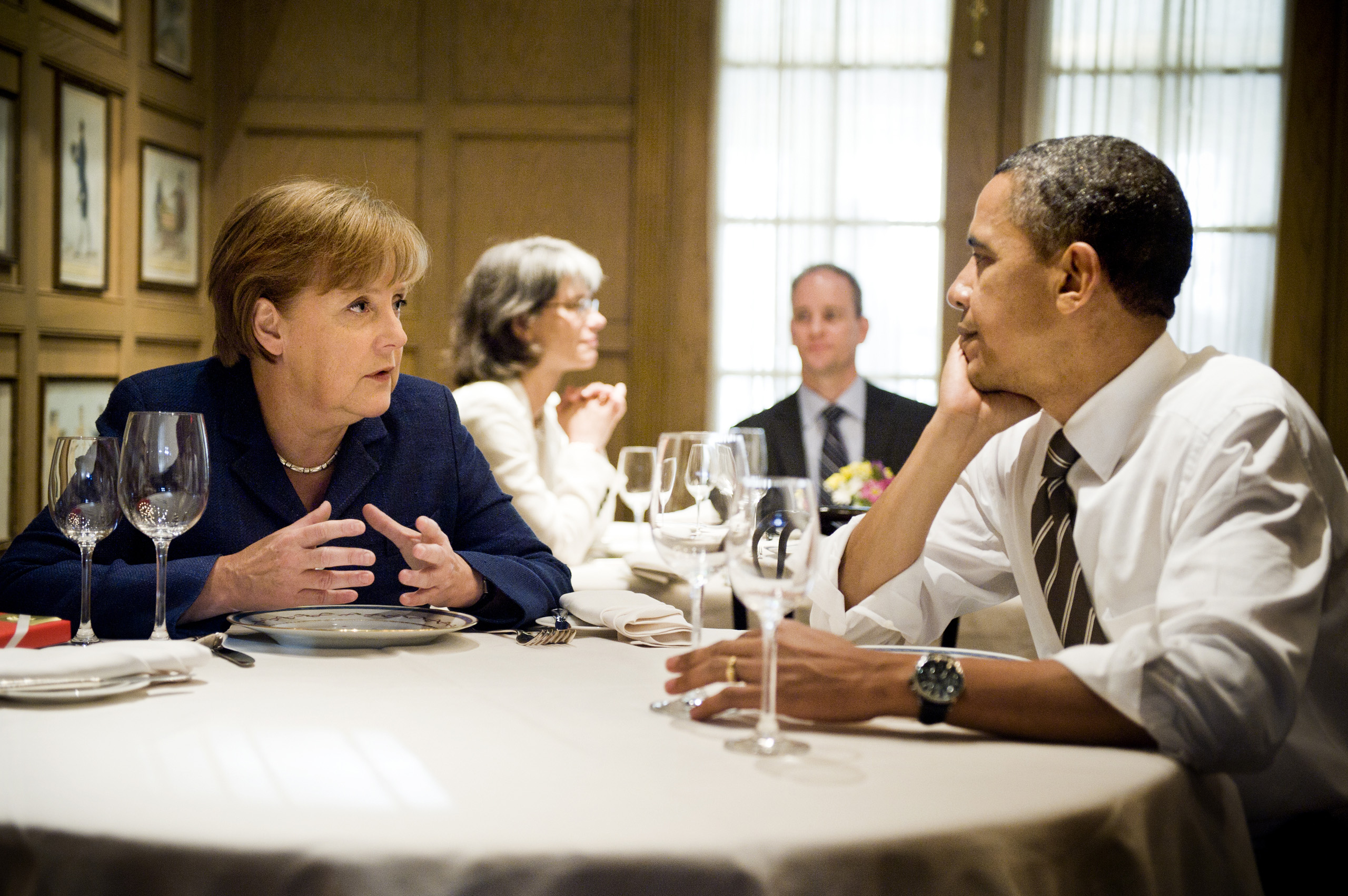 Chancellor Merkel and President Obama talk in a restaurant in Washington D.C. June 7, 2011.