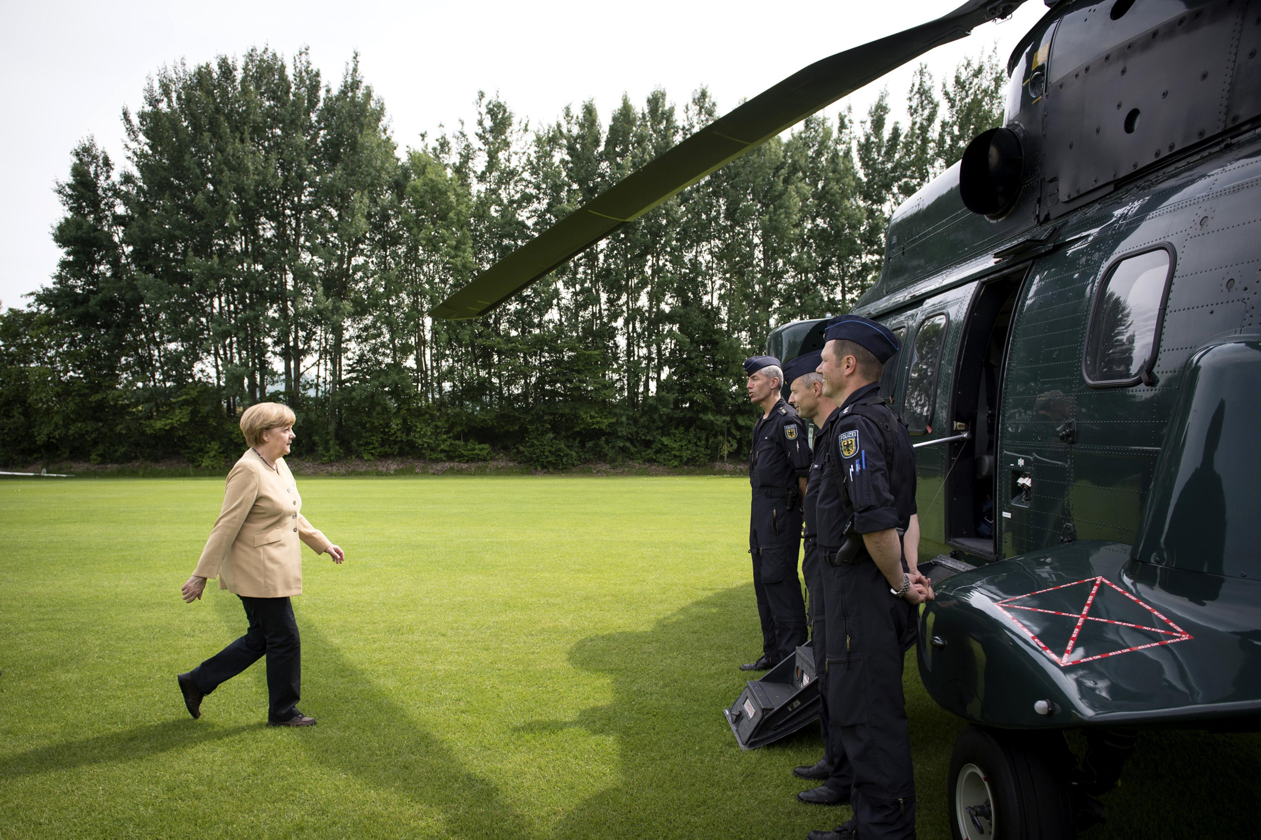 Chancellor Angela Merkel about to board a police helicopter after visiting the region of Hitzacker, Lower Saxony, which was hit by severe flooding. June 12, 2013.