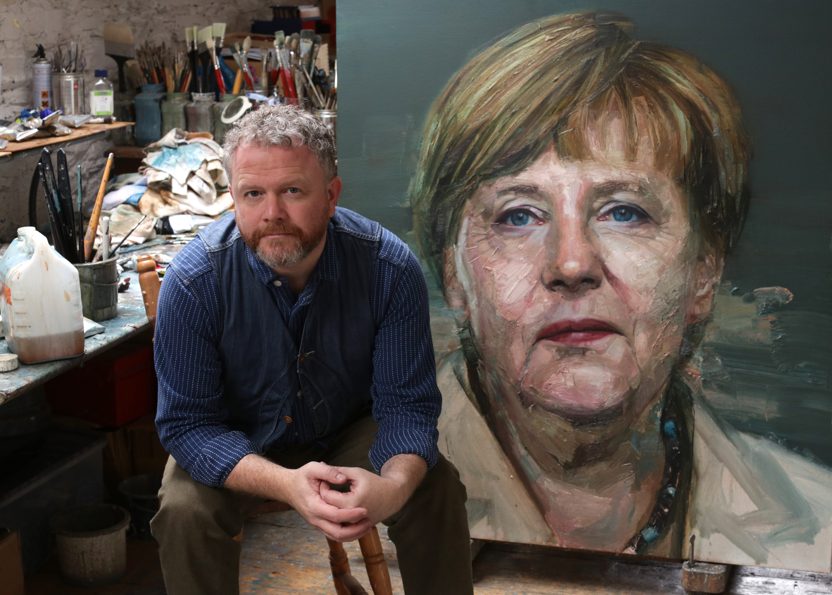Artist Colin Davidson with his painting of Angela Merkel commissioned for the cover of TIME's  2015 Person of the Year issue