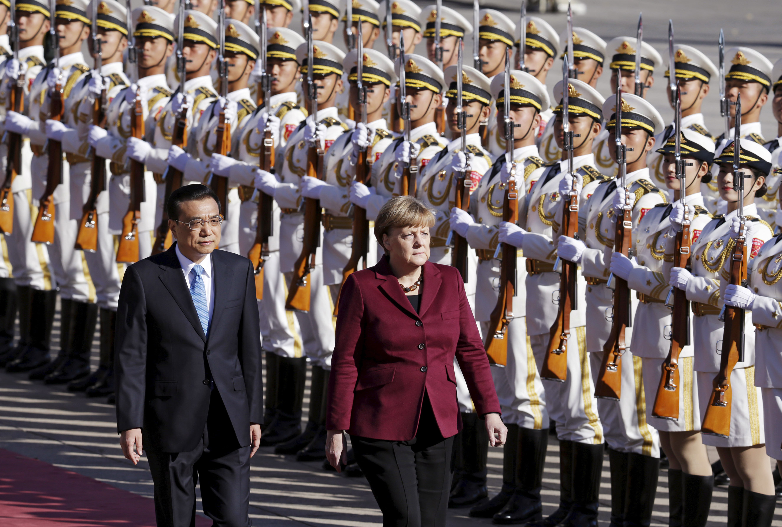 October: China's Premier Li Keqiang and Chancellor Angela Merkel inspect honor guards during a welcoming ceremony outside the Great Hall of the People in Beijing on Oct. 29, 2015.