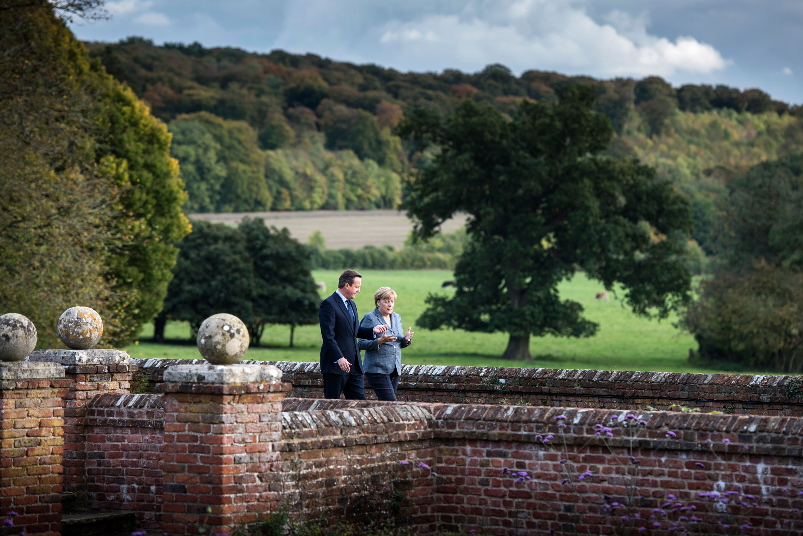 October: Chancellor Angela Merkel and British Prime Minister David Cameron talk at the beginning of their meeting at the country residence of the prime minister at Chequers in Buckinghamshire, England on Oct. 9, 2015.