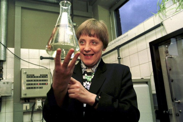 Former Federal Minister Merkel is holding up a test tube filled with water in water-control-station of Bad Honnef on Jan. 12, 1995.