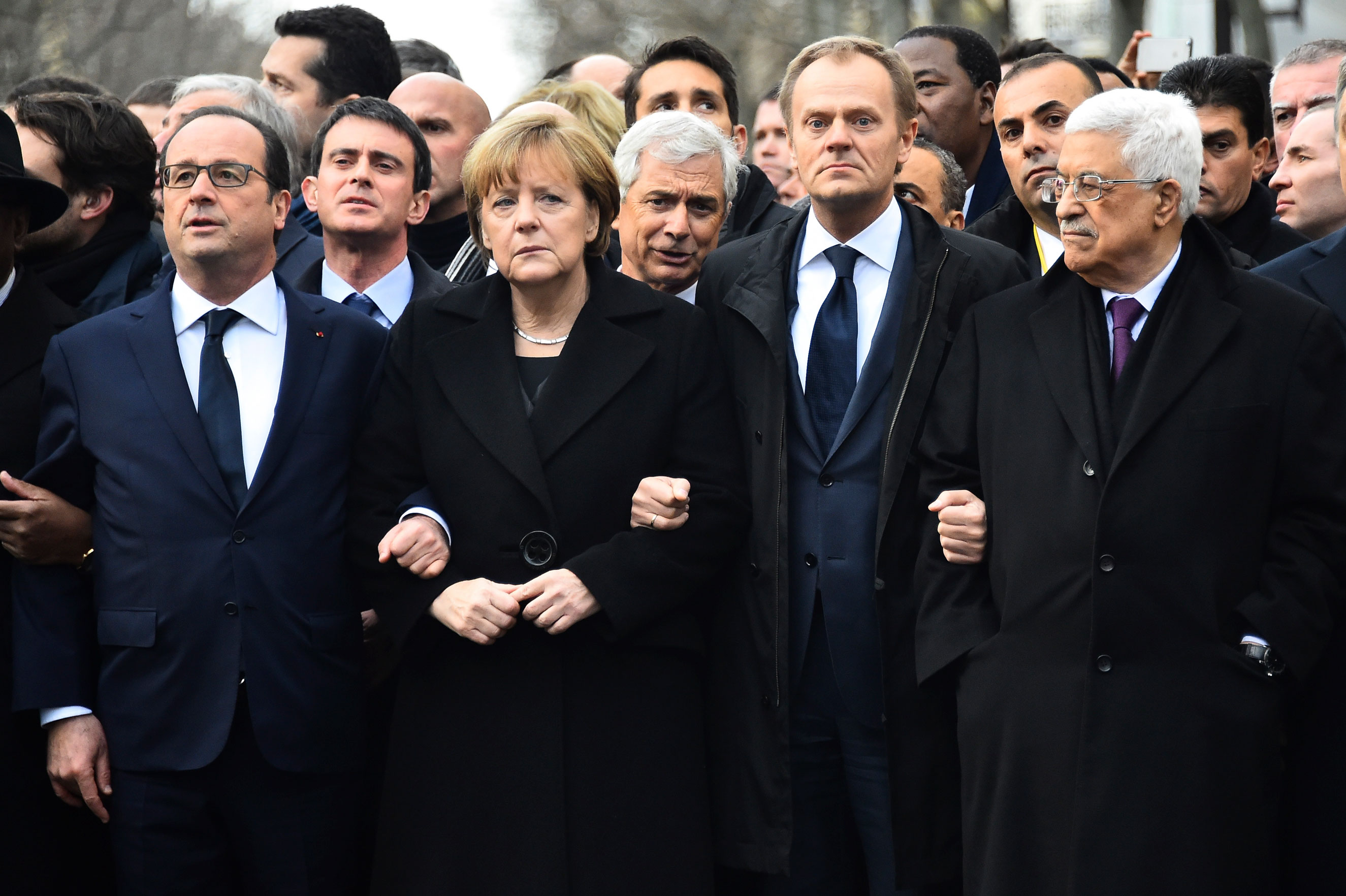 January: From left: French President Francois Hollande, German Chancellor Angela Merkel, President of the European Council Donald Tusk, Palestinian Authority President Mahmoud Abbas link arms during a silent march against terrorism in Paris on Jan. 11, 2015 following the attack on French satirical weekly Charlie Hebdo and a kosher supermarket.