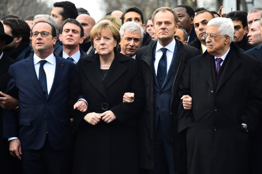 From left: French President Francois Hollande, German Chancellor Angela Merkel, President of the European Council Donald Tusk, Palestinian Authority President Mahmoud Abbas link arms during a silent march against terrorism in Paris on Jan. 11, 2015 following the attack on French satirical weekly Charlie Hebdo and a kosher supermarket.