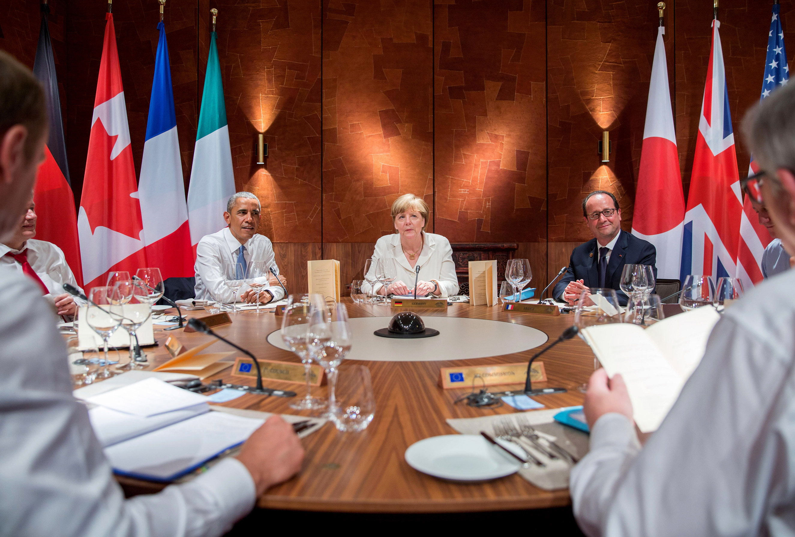 June: From left: U.S. President Barack Obama, Chancellor Angela Merkel and France's President Francois Hollande attend a working dinner at the G7 summit at the castle Elmau in Kruen, Germany on June 7, 2015. Leaders from the Group of Seven (G7) industrial nations met in the Bavarian Alps for a summit overshadowed by Greece's debt crisis and ongoing violence in Ukraine.