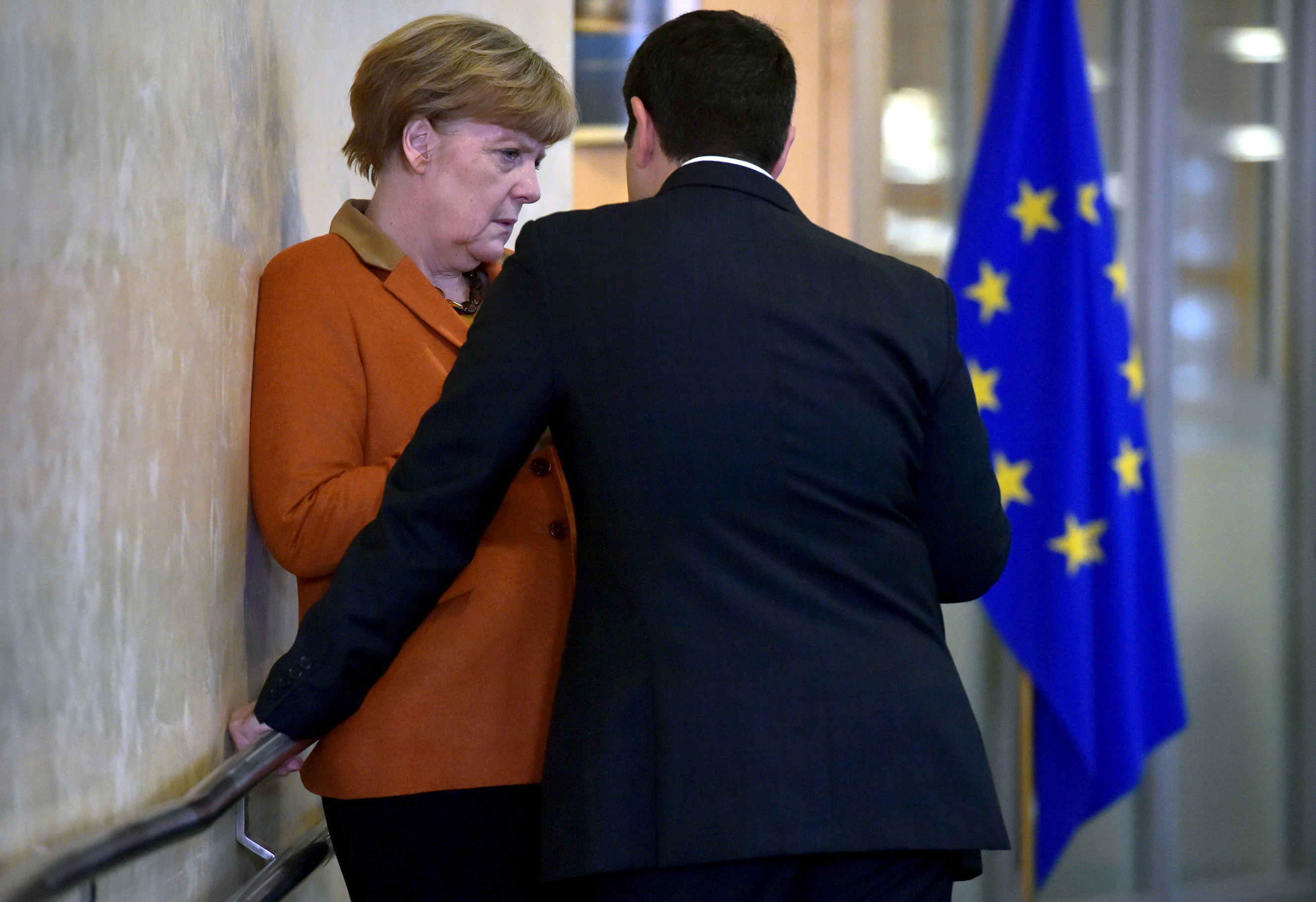 October: Greece's Prime Minister Alexis Tsipras talks with Chancellor Angela Merkel prior to a meeting over the Balkan refugee crisis with leaders from central and eastern Europe at the EU Commission headquarters in Brussels on Oct. 25, 2015.