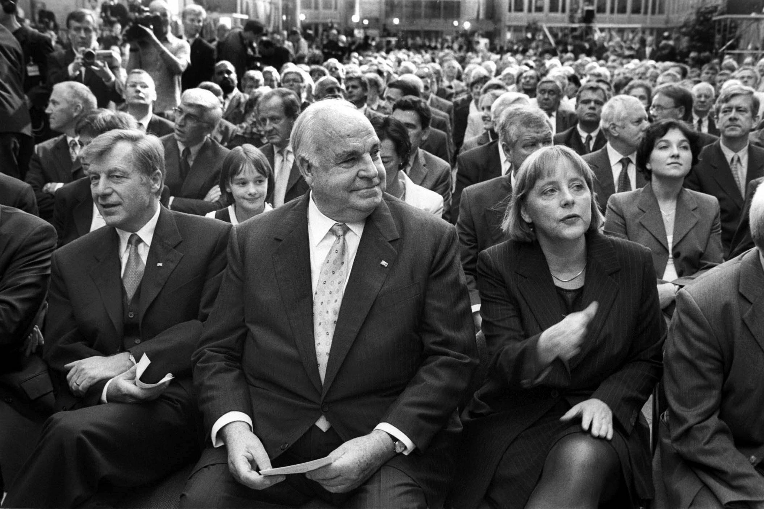 From left: Eberhard Diepgen, Helmut Kohl, and Angela Merkel attend a CDU ceremony on Oct. 1, 2000.