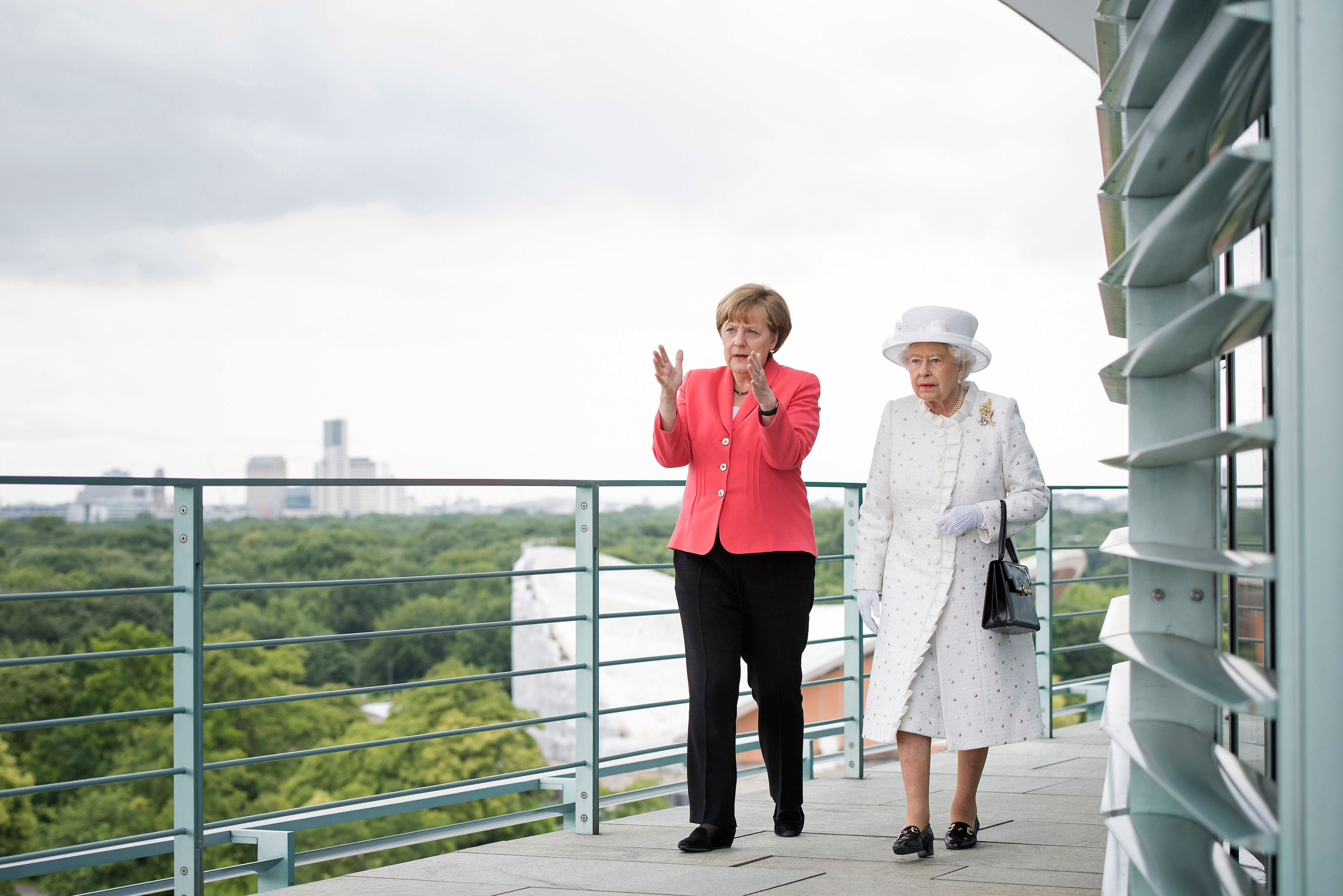 June: Chancellor Angela Merkel welcomes Queen Elizabeth II upon her arrival at the Federal Chancellery during the royal couple's four-day visit to Germany on June 24, 2015 in Berlin. The Queen and Prince Philip visited Berlin, Frankfurt and the concentration camp memorial at Bergen-Belsen during their first to Germany since 2004.