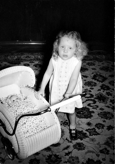 Angela Kasner as a child with a stroller.
