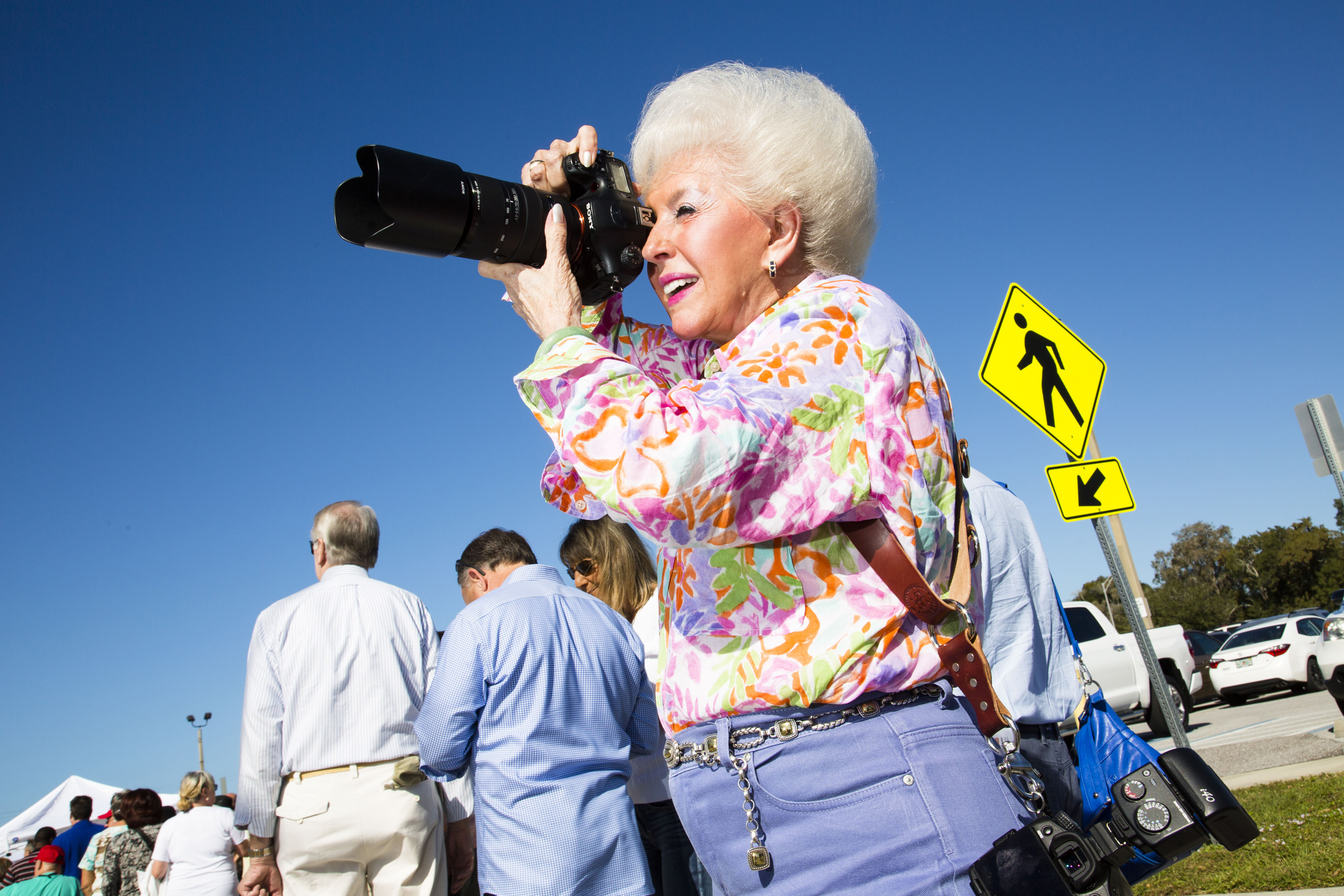 Supporter of Republican presidential candidate Donald Trump photographs at a Donald Trump rally in Sarasota, Fla. Nov. 28, 2015.