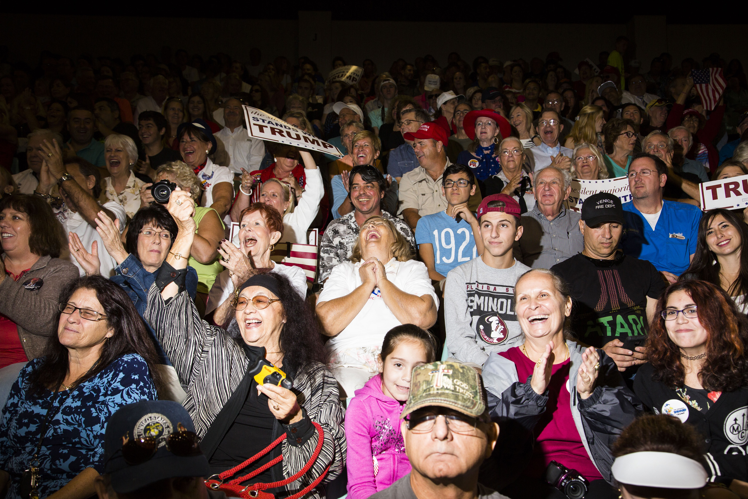 Supporters of Republican presidential candidate Donald Trump react to speakers at a rally in Sarasota, Fla. Nov. 28, 2015.