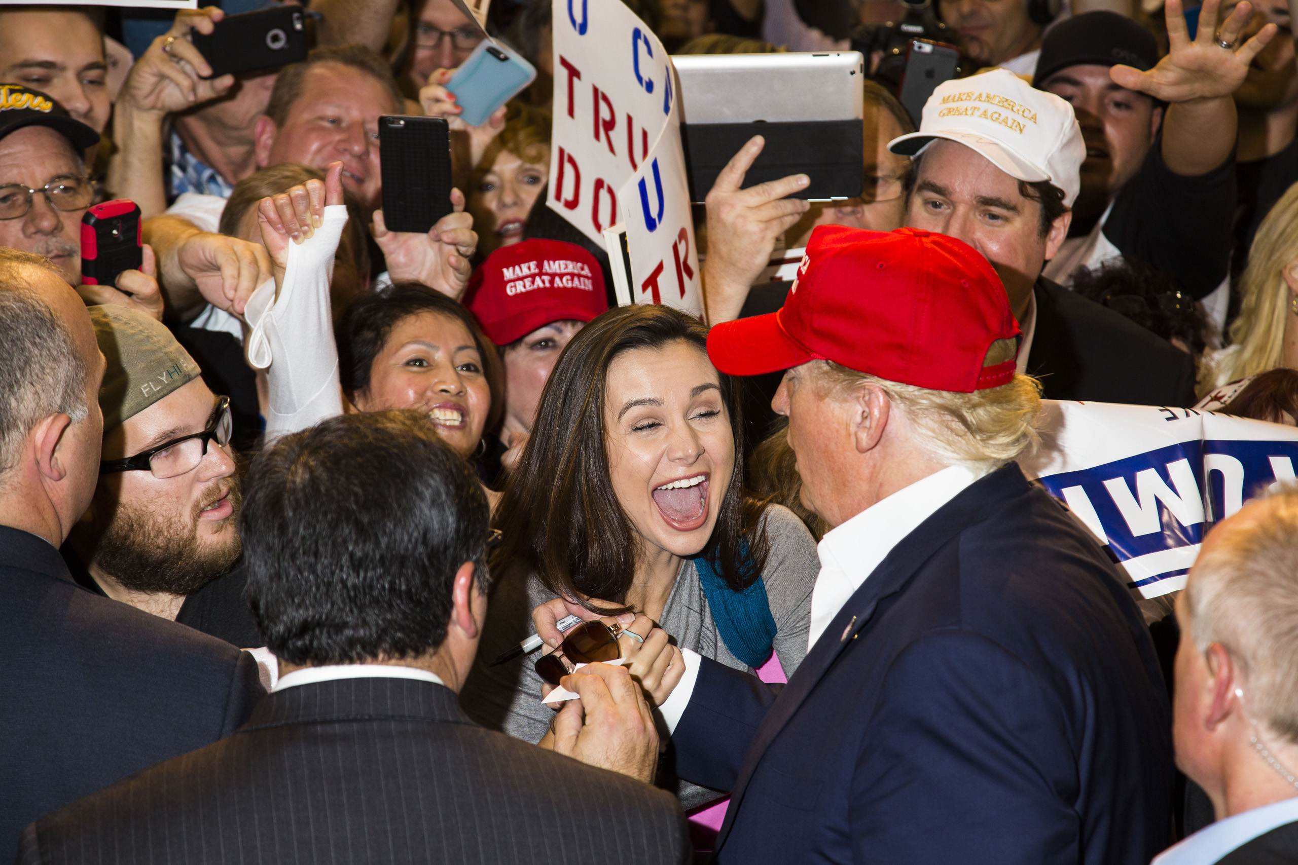An audience member reacts to getting an autograph from Republican presidential candidate Donald Trump following his rally in Sarasota, Fla. Nov. 28, 2015.