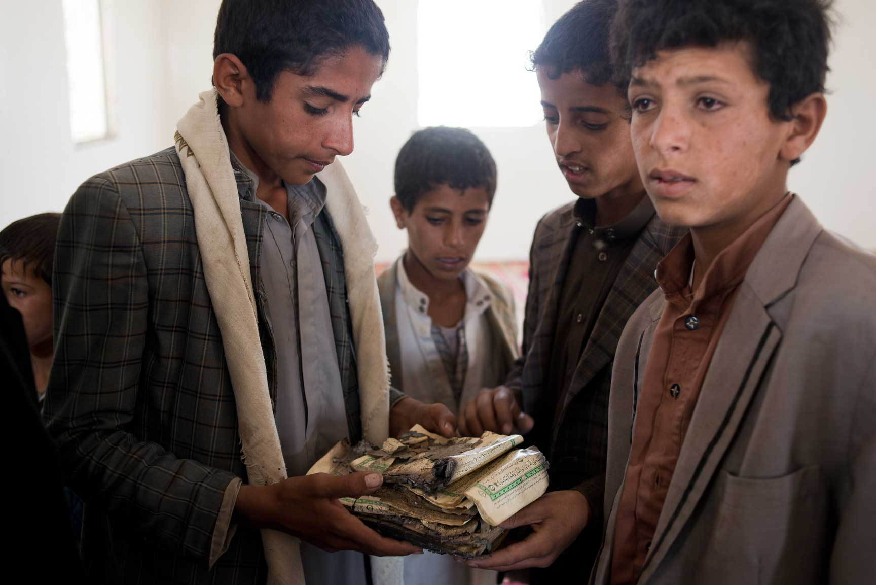 Yemeni boys survey the damage to a mosque after an airstrike on Thursday, July 7, 2015 in Al Joob Village, Yemen. Two airstrikes on July 6 hit a public market near homes and a mosque and farmers selling produce on the side of the road; the two combined killed over 30 civilians.