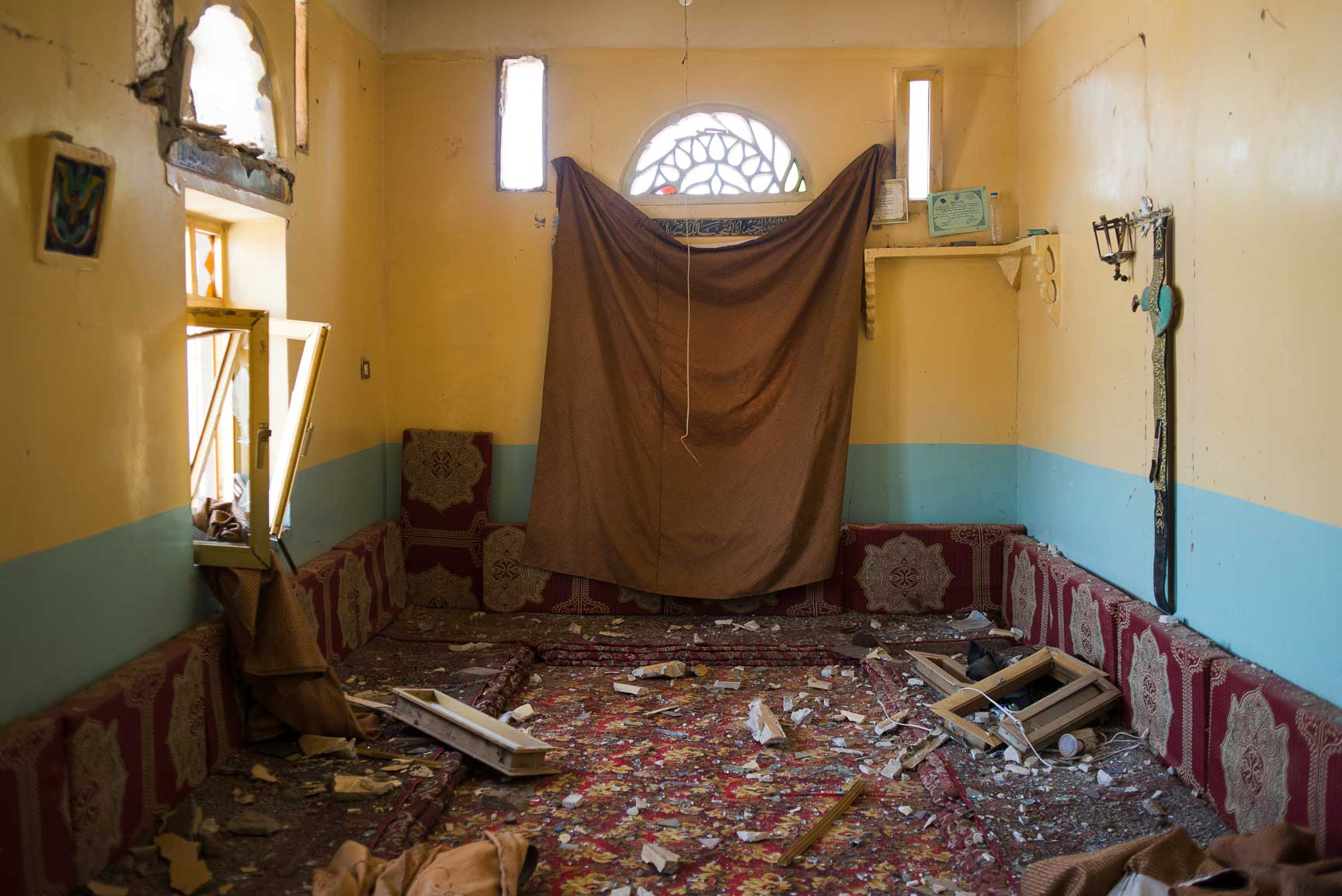 Glass and concrete cover the floor of a home after an airstrike hit an open-air market, Thursday July 7, 2015 in al Joob Village, Yemen. Two airstrikes on July 6 hit a public market near homes and a mosque and farmers selling produce on the side of the road; the two combined killed over 30 civilians.