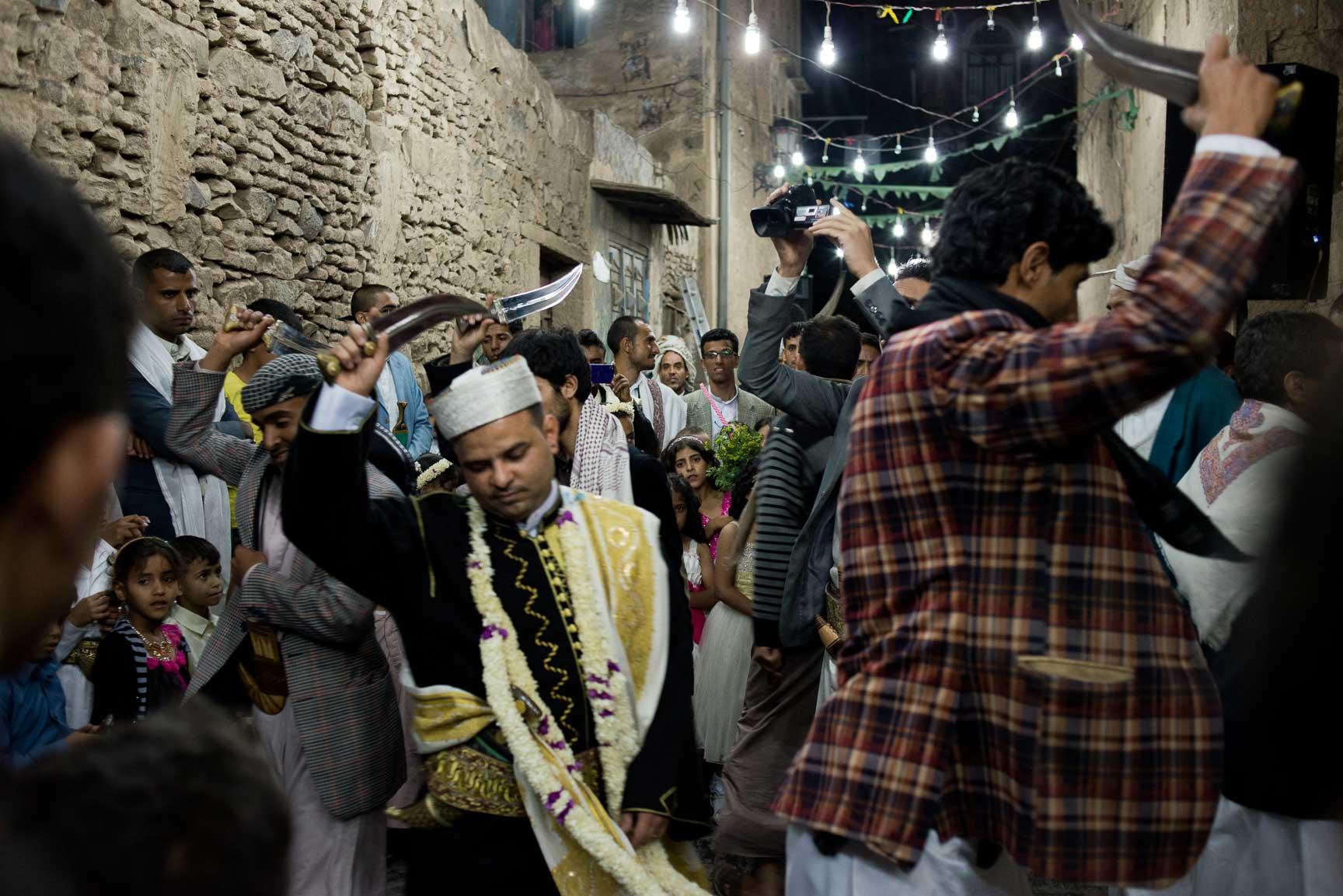 Yemeni men dance the bara'a, a traditional tribal dance of northern Yemen for a wedding celebration on June 4, 2015 in Sana'a, Yemen.
