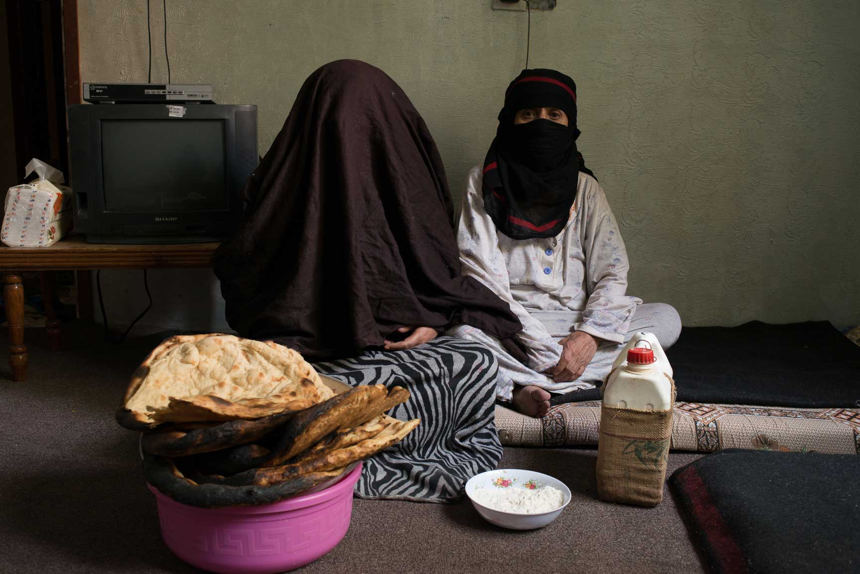 Yemeni women displaced from Sa'ada by airstrikes, sit for a portrait in the home of a Yemeni family that is hosting them on June 10, 2015 in Sana'a, Yemen. A young boy in their family has leukemia, and three men from their family shared a single motorcycle for the eight our ride to Sana'a from Sa'daa.