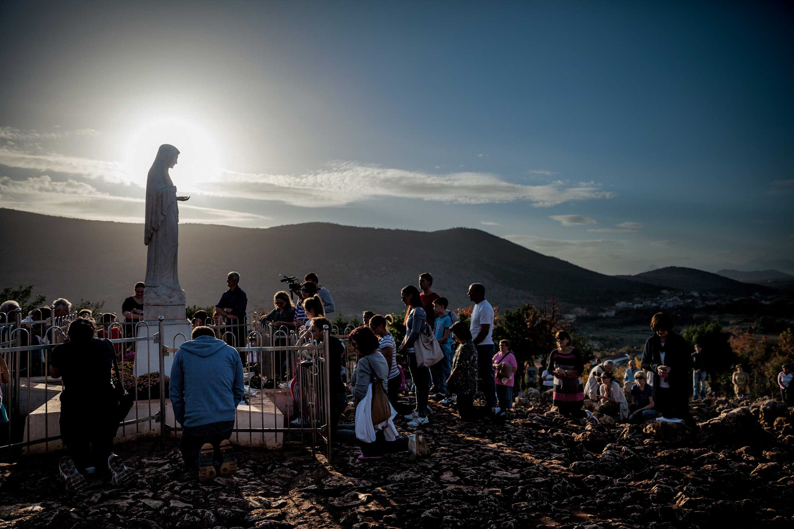 From National Geographic Magazine's December issue: How the Virgin Mary Became the World's Most Powerful WomanAs the sun sets in Medjugorje, Bosnia and Herzegovina—a hot spot for Virgin Mary sightings—devotees of diverse faiths and nationalities gather to pray.