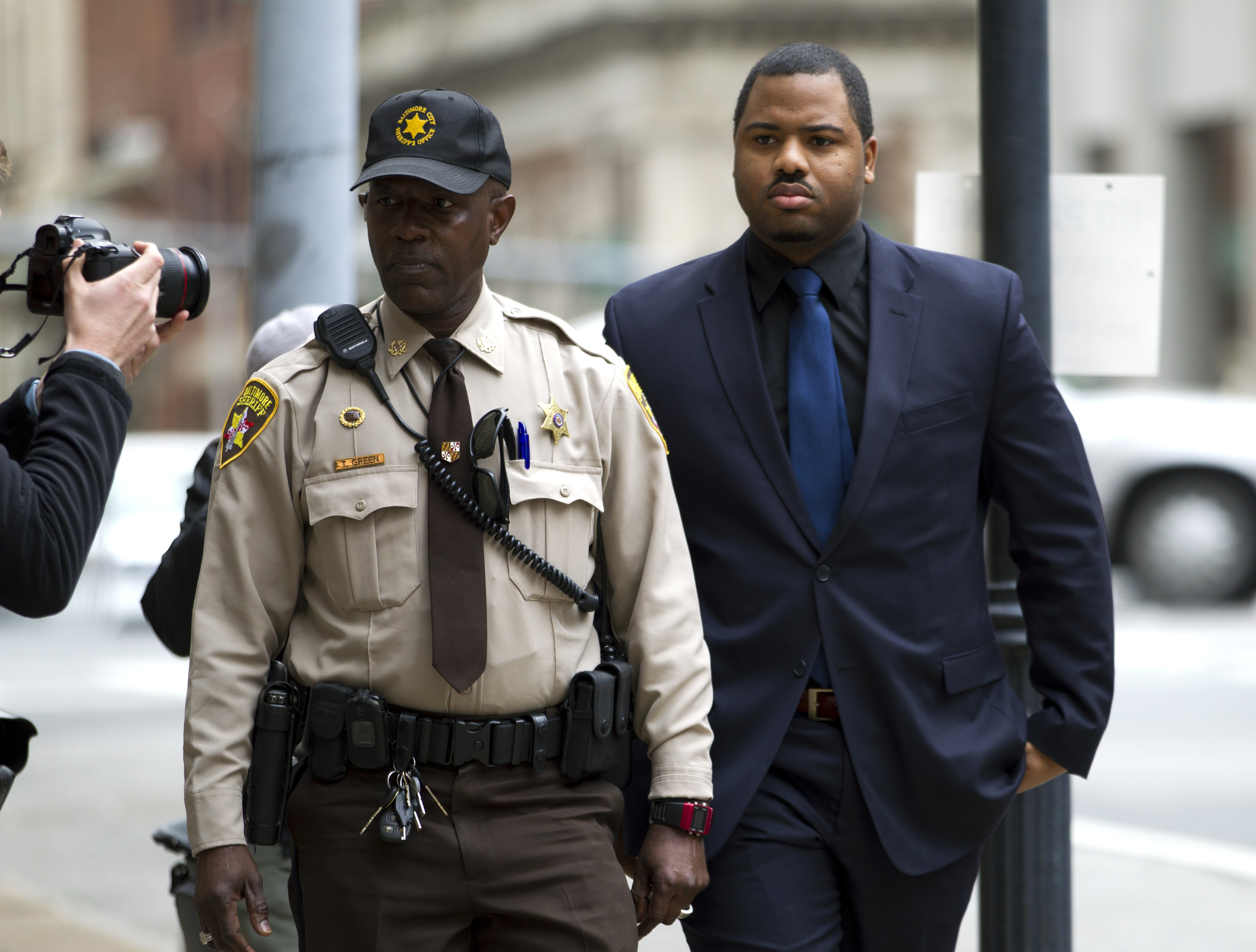 Officer William Porter arrives at a courthouse as jury deliberations continue in his trial on Dec. 16, 2015, in Baltimore Md.