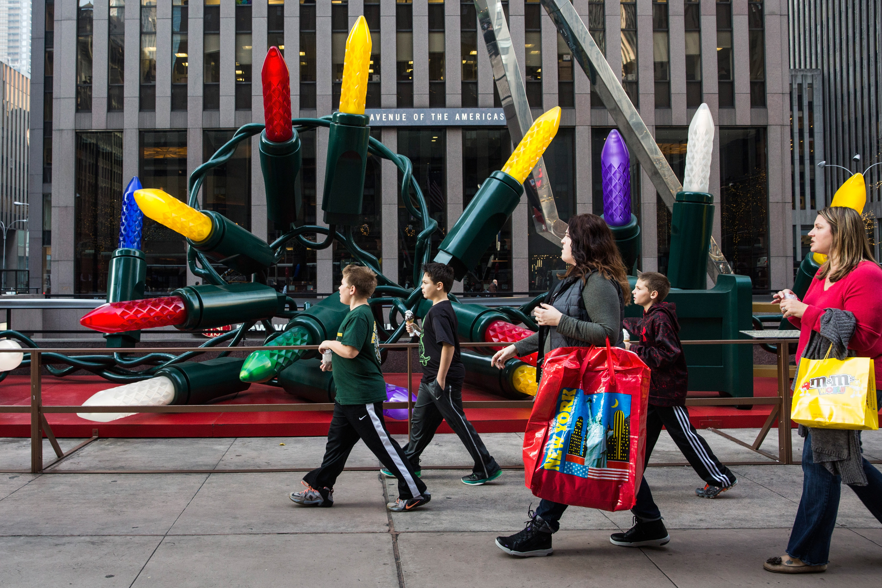 Children walk down Sixth Avenue wearing t-shirts thanks to 60 degree weather on Dec. 10, 2015 in New York City.