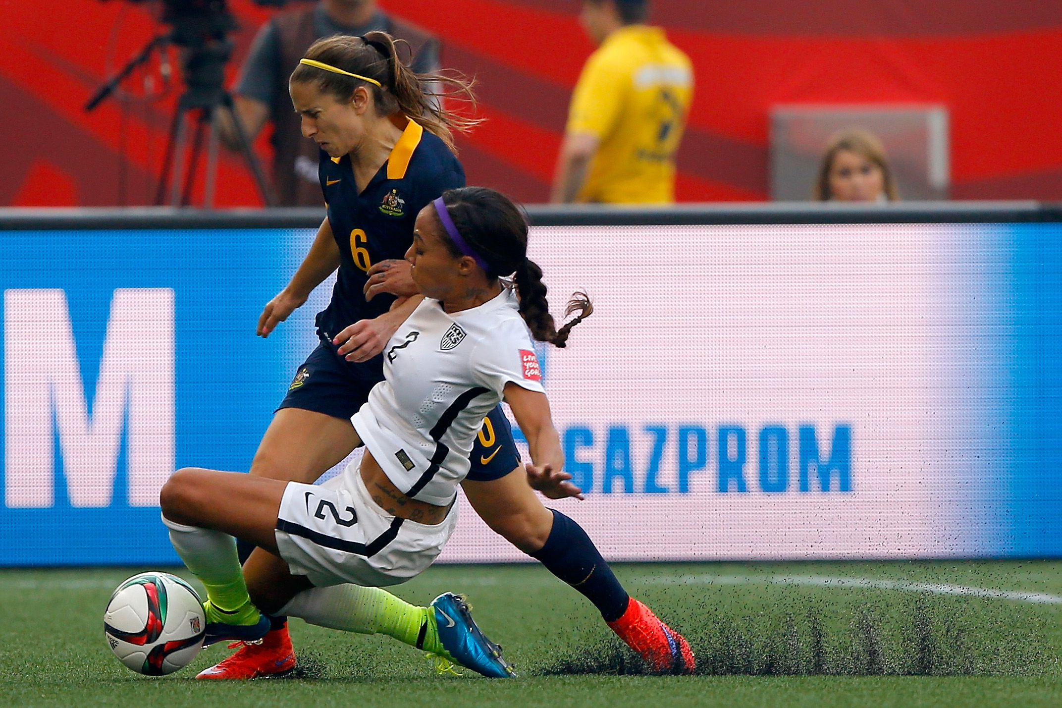 Sydney Leroux of the U.S. challenges Servet Uzunlar of Australia in the first half during the FIFA Women's World Cup 2015 Group D match at Winnipeg Stadium in Winnipeg, Canada, on June 8, 2015