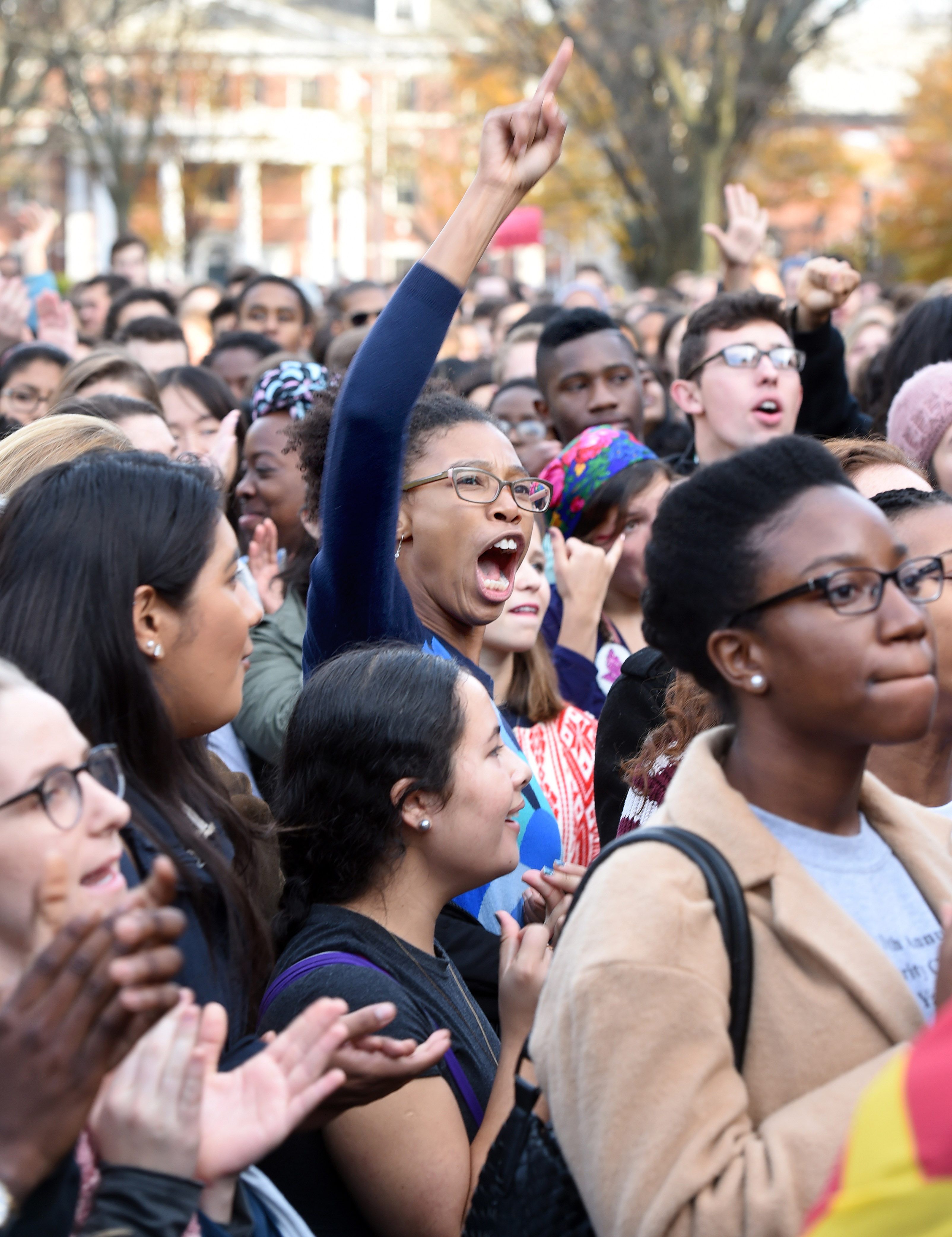 Yale University students and faculty rally to demand that Yale University become more inclusive to all students.