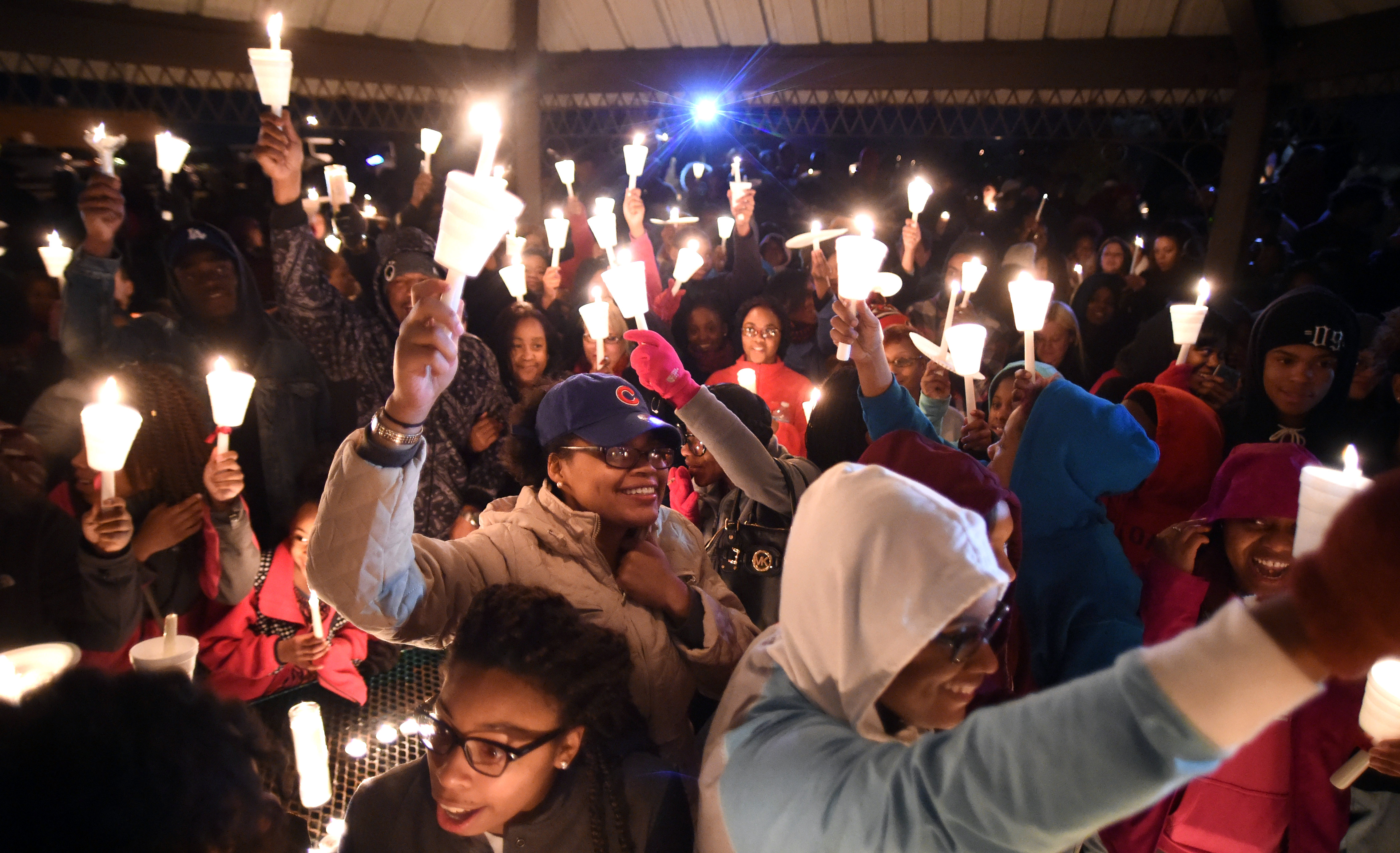 Attendees raise candles to celebrate the life of Zaevion Dobson at Sam E. Hill Park in Knoxville, Tenn., on Dec. 18, 2015.