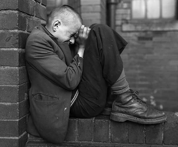 Youth on wall, Jarrow, Tyneside, 1976