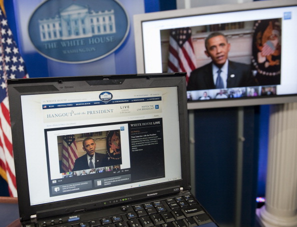 US President Barack Obama participates in an interview with YouTube and Google from the Roosevelt Room of the White House in Washington, DC, January 30, 2012, as seen on a laptop in the Brady Press Briefing Room. The interview, held through a Google+ Hangout, marks the first completely virtual interview of a US President from the White House.  SAUL LOEB—AFP/Getty Images