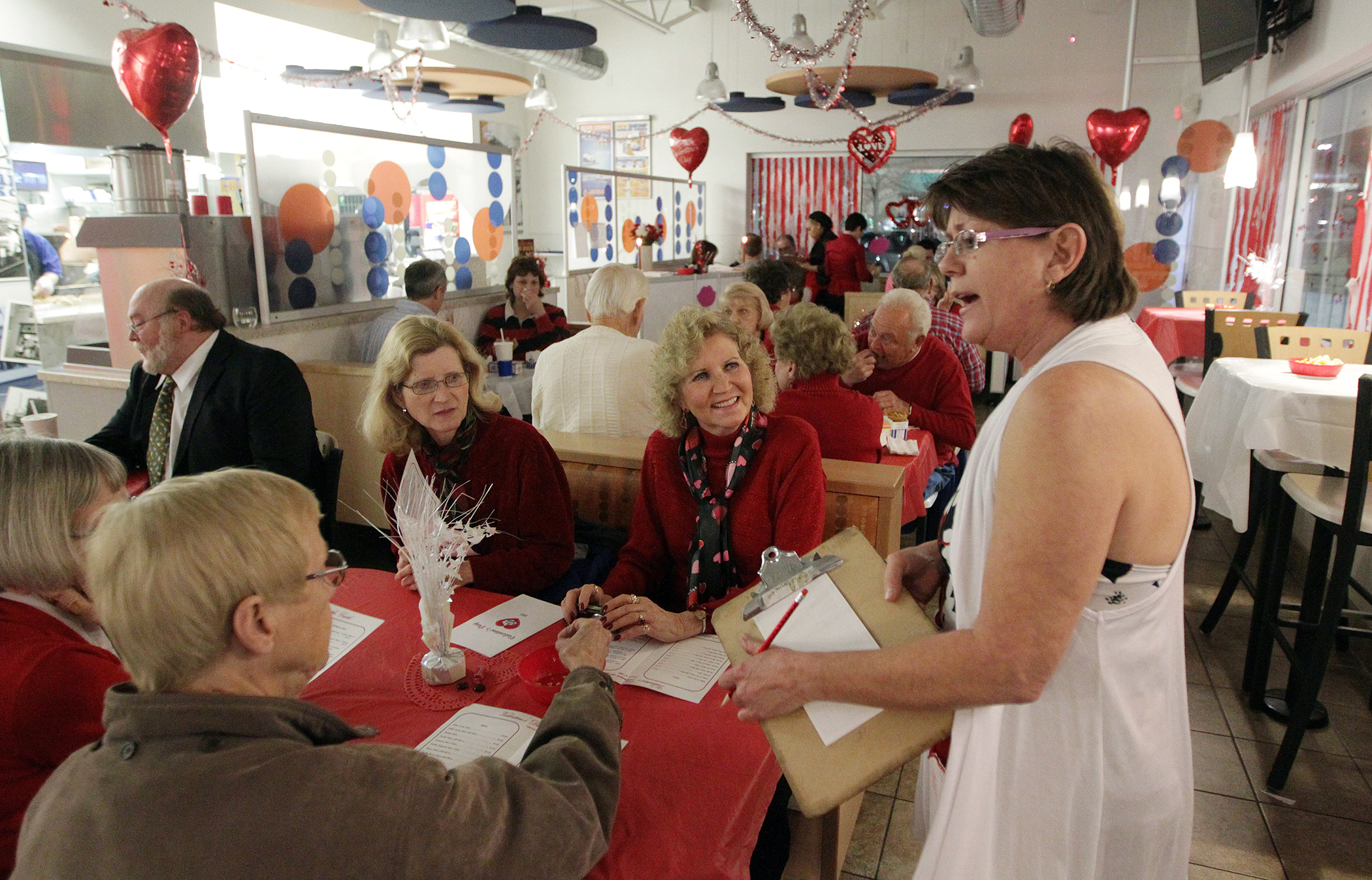 A waiter takes orders during a previous White Castle Valentine's Day dinner.