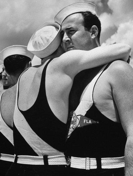 Two lifeguards hugging, Florida, 1939.