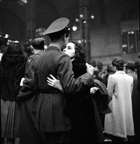 Soldier hugging his wife goodbye at Penn Station before he leaves for war, 1944.