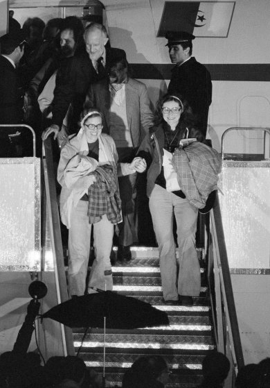 Kathryn Koob, right, and Elizabeth Ann Swift hold hands as they leave the Algerian aircraft which brought them to Algiers from Tehran at Algiers airport, Jan. 21, 1981. The women were two of the United States hostages held for 444 days in Iran.