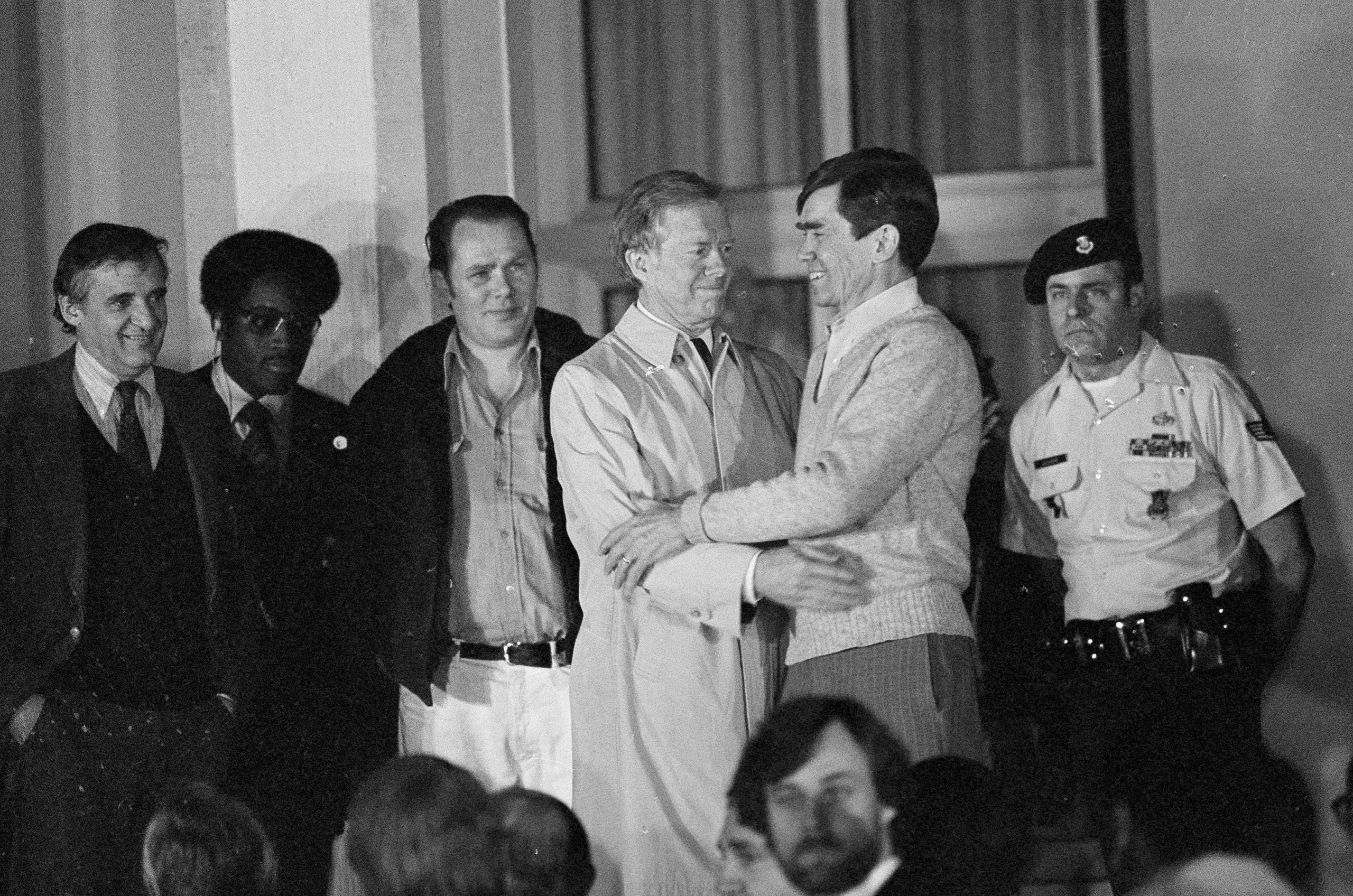 Former U.S. president Jimmy Carter, who came to Wiesbaden to greet the U.S. hostages released from captivity, embraces one of the former hostages, believed to be Bruce Laingen, Jan. 21, 1981.