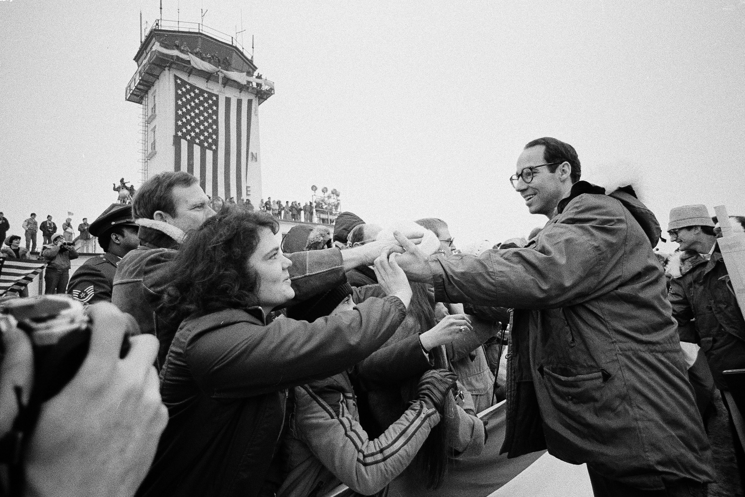 Former American hostage John Graves from Reston, Va., shakes hands with people in the crowd at the Rhein-Main U.S. Air Force base in Frankfurt, West Germany on Jan. 21, 1981, shortly before traveling home to the United States.