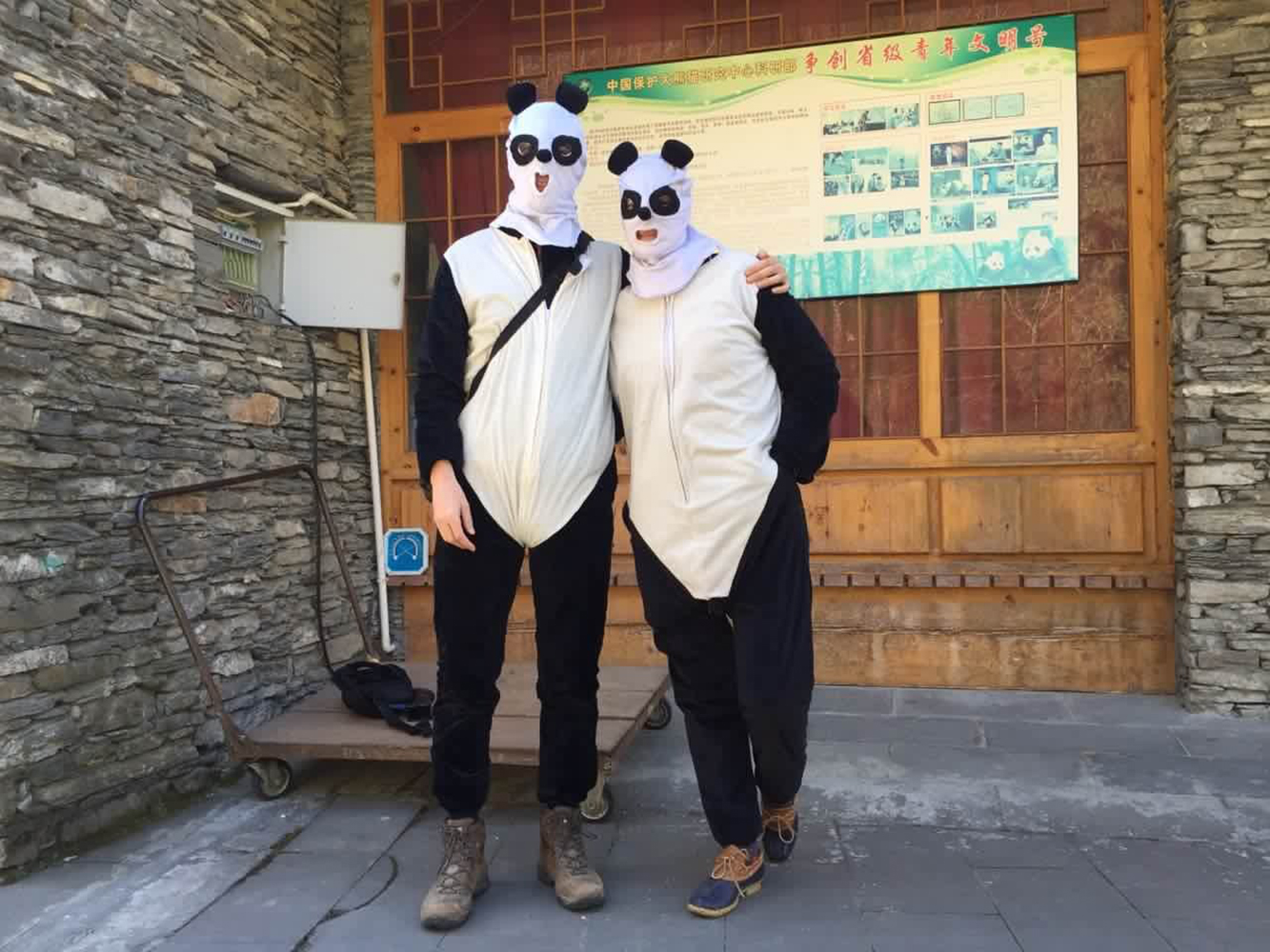 Photographer Adam Dean and TIME East Asia bureau chief Hannah Beech wearing panda costumes while they report on the pandas at the Hetaoping Research and Conservation Center for the Giant Panda in Wolong National Natural Reserve, Sichuan province, China, on Dec. 1, 2015
