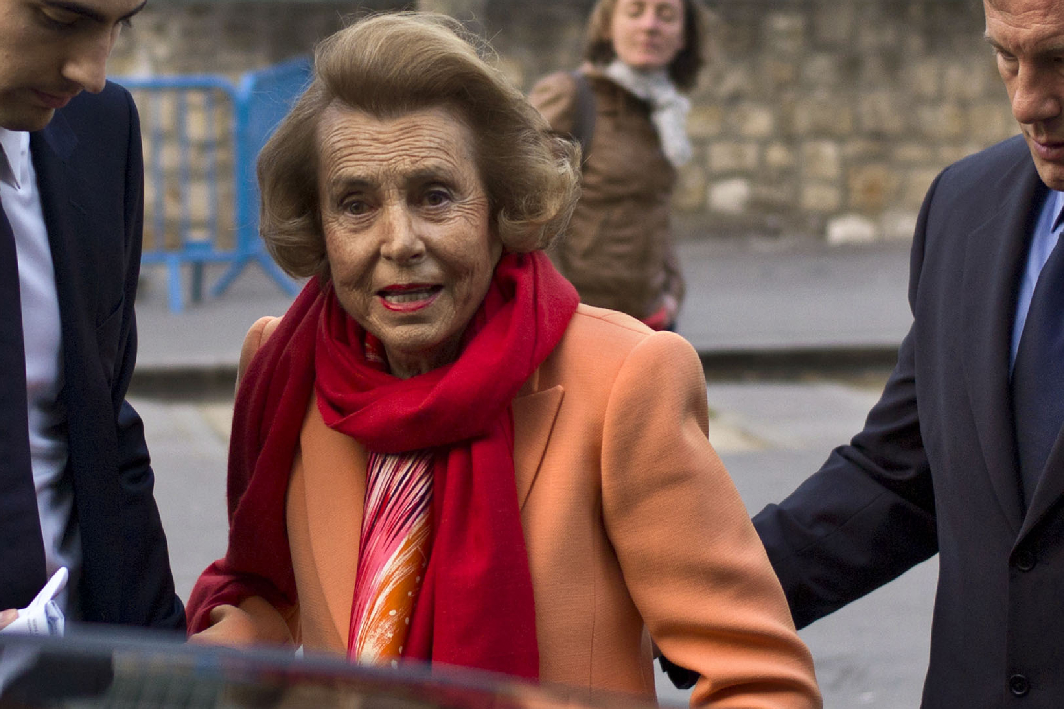 L'Oreal heiress Liliane Bettencourt, center, and her grandson Jean-Victor Meyers, second from left, leave the L'Oreal-UNESCO prize for the women in science, in Paris, March 29, 2012.