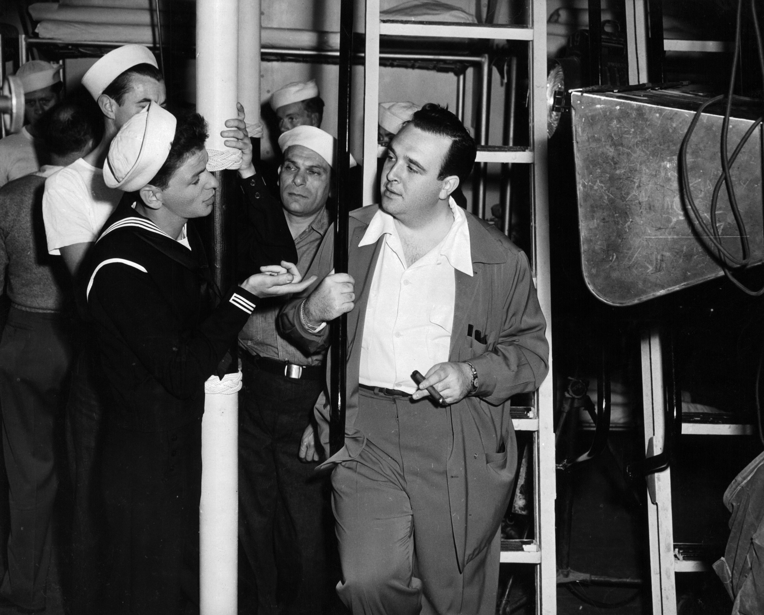 Frank Sinatra having conversation with director George Sidney in between scenes from the film 'Anchors Aweigh', 1945.
