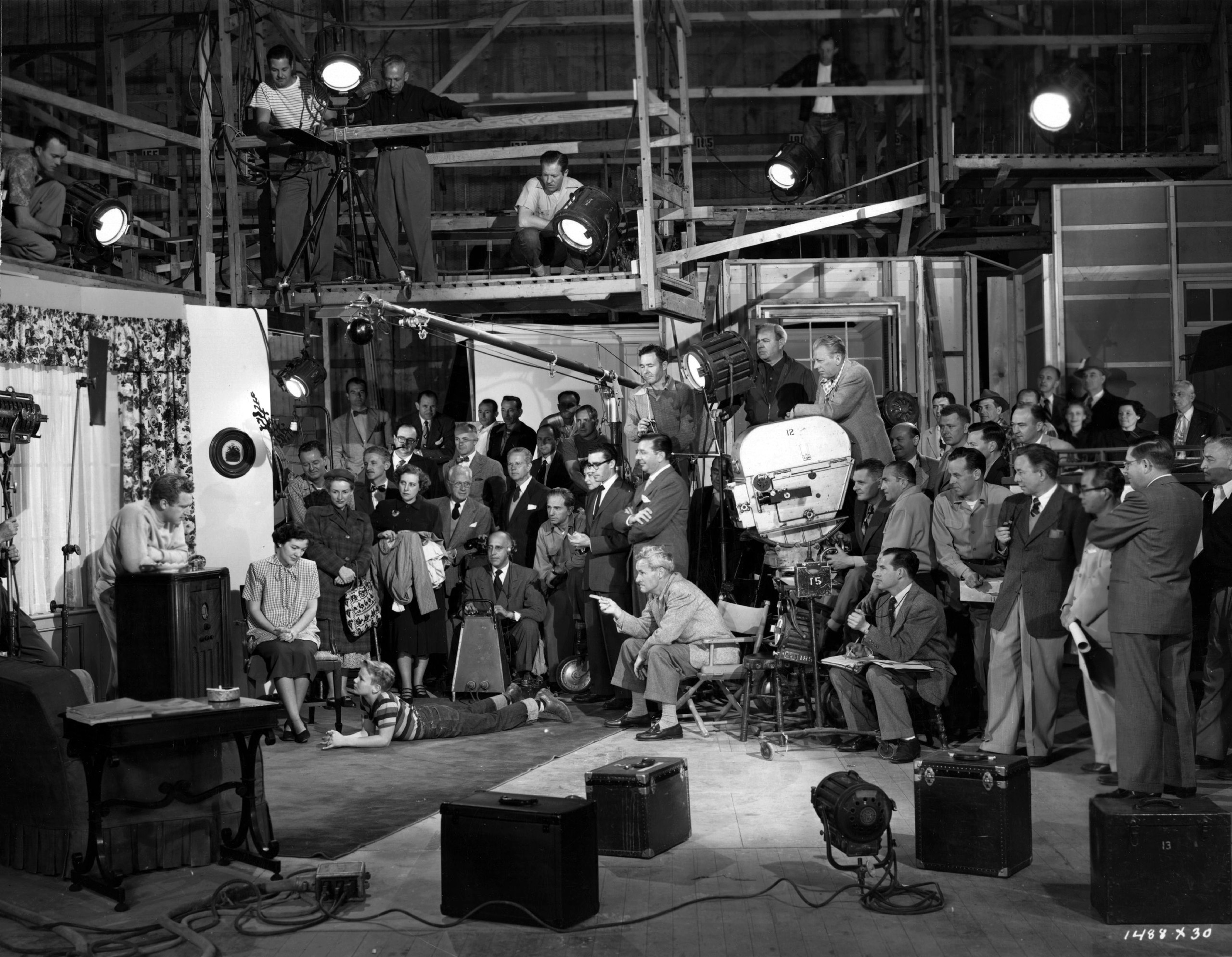 The technicians, craftsmen and studio personnel - the  small army of workers behind  the scenes -  during the filming of MGM's 'The Next Voice You Hear.' 1950.