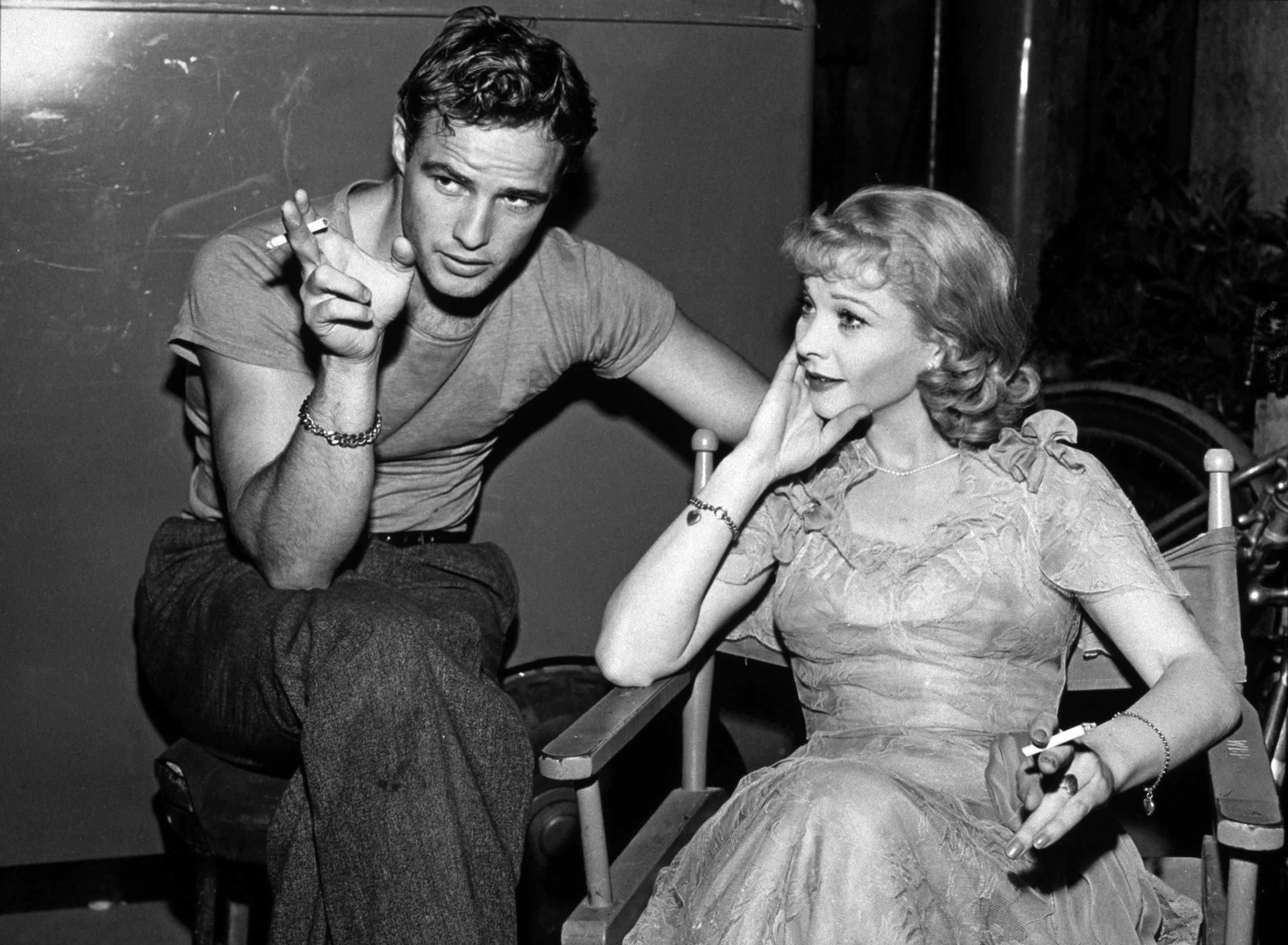 Marlon Brando and Vivien Leigh relax on the set of 'A Streetcar Named Desire', circa 1951.